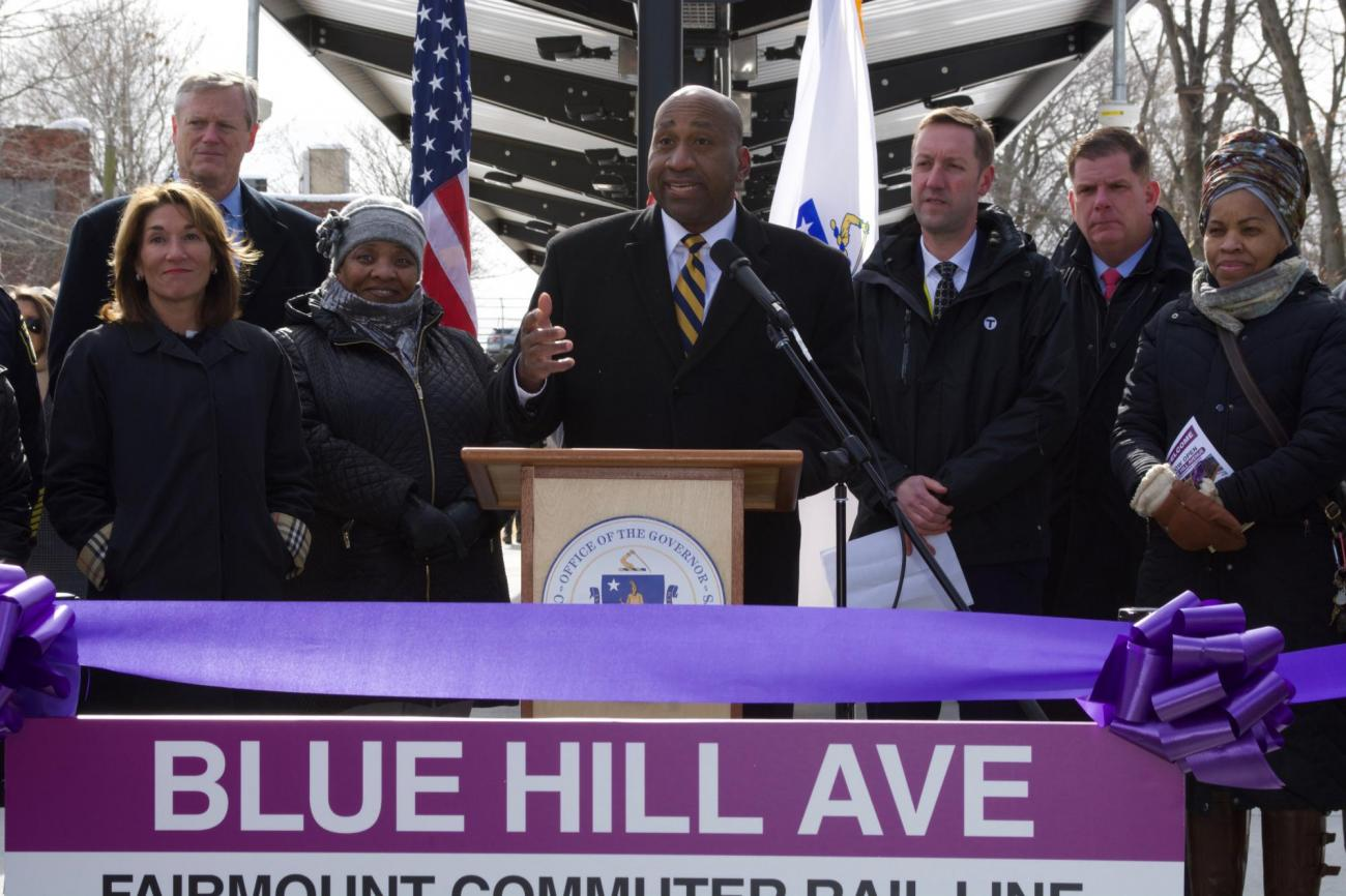 Representative Russell Holmes speaking at the Blue Hill Ave opening