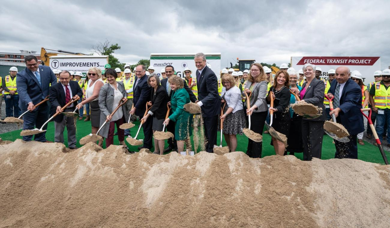 Officials in a row with shovels during the GLX groundbreaking