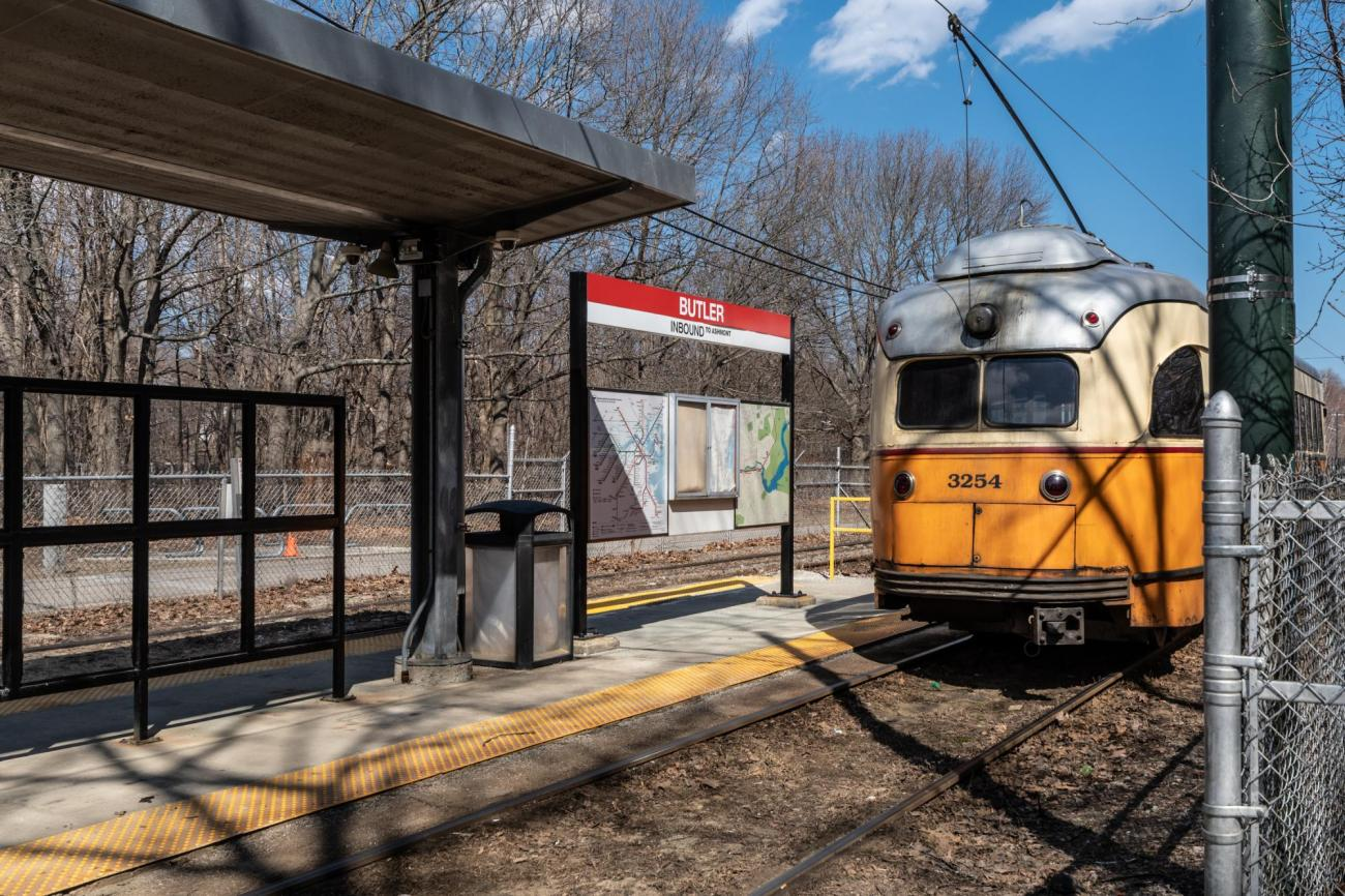 A Mattapan Line trolley approaches the Butler Station platform