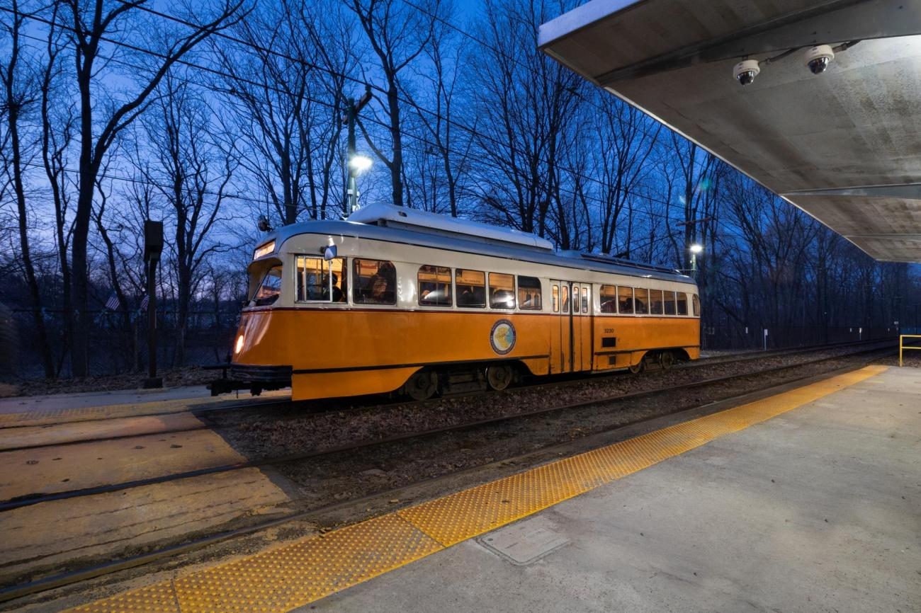 At night, a Mattapan Line trolley passes through the Valley Road Station