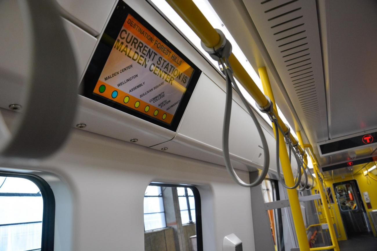 Interior of Orange Line pilot car, with an LCD screen
