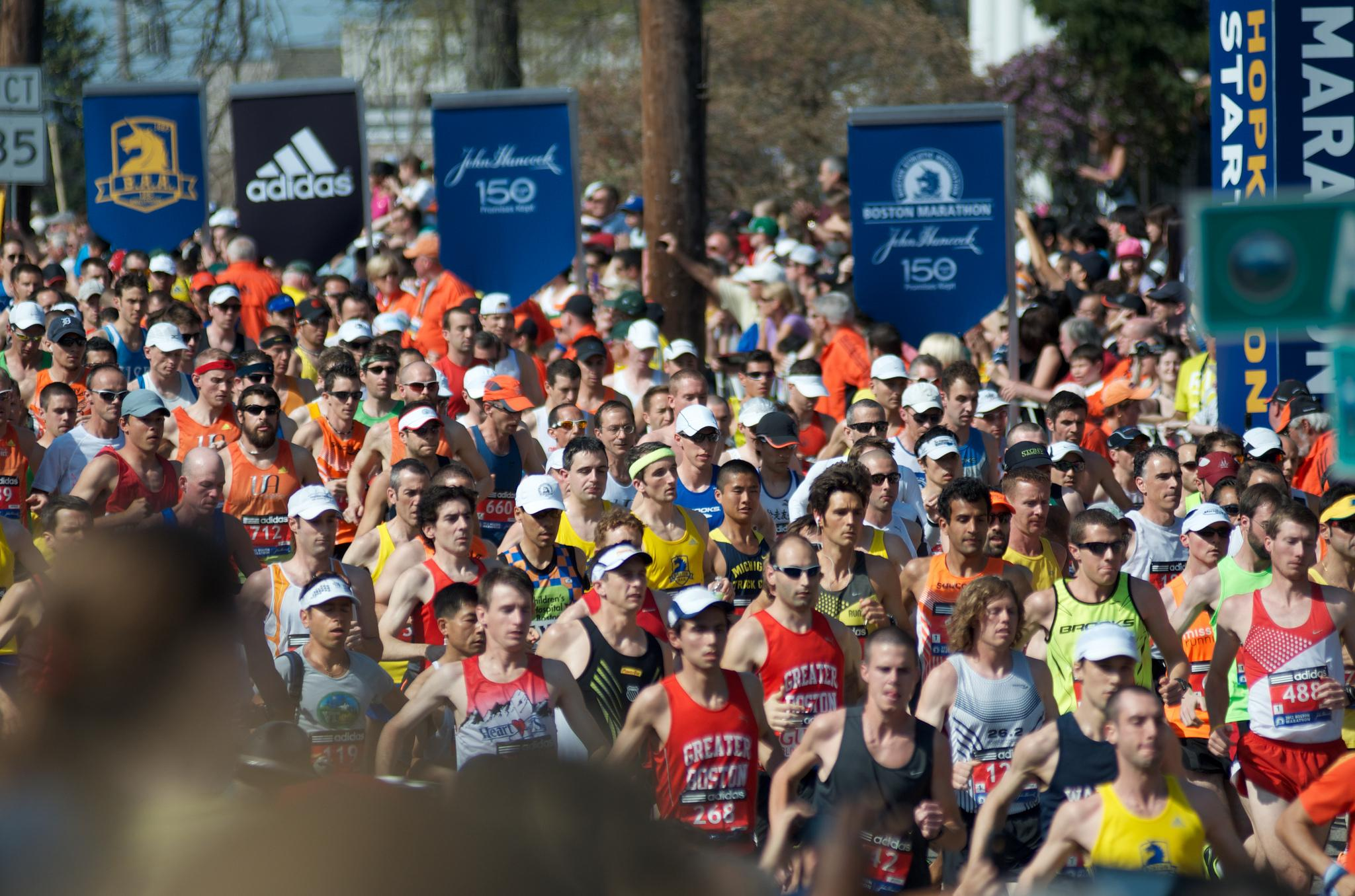 Runners in the 116th Boston Marathon take off with the starting gun at the starting line in Hopkinton. Photo by Ryan Hutton, Boston University News Service, made available by BU Interactive News on Flickr (CC BY 2.0)