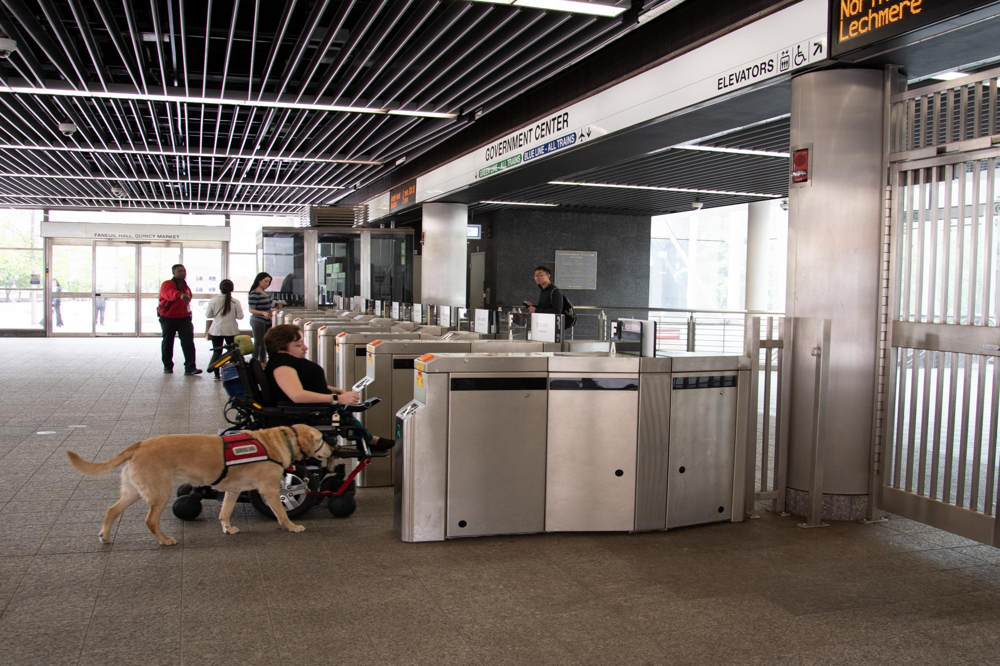 customer entering government center accessible fare gate