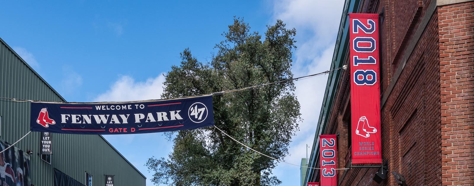 Banners hanging outside of Fenway Park, celebrating the years the Sox won the World Series
