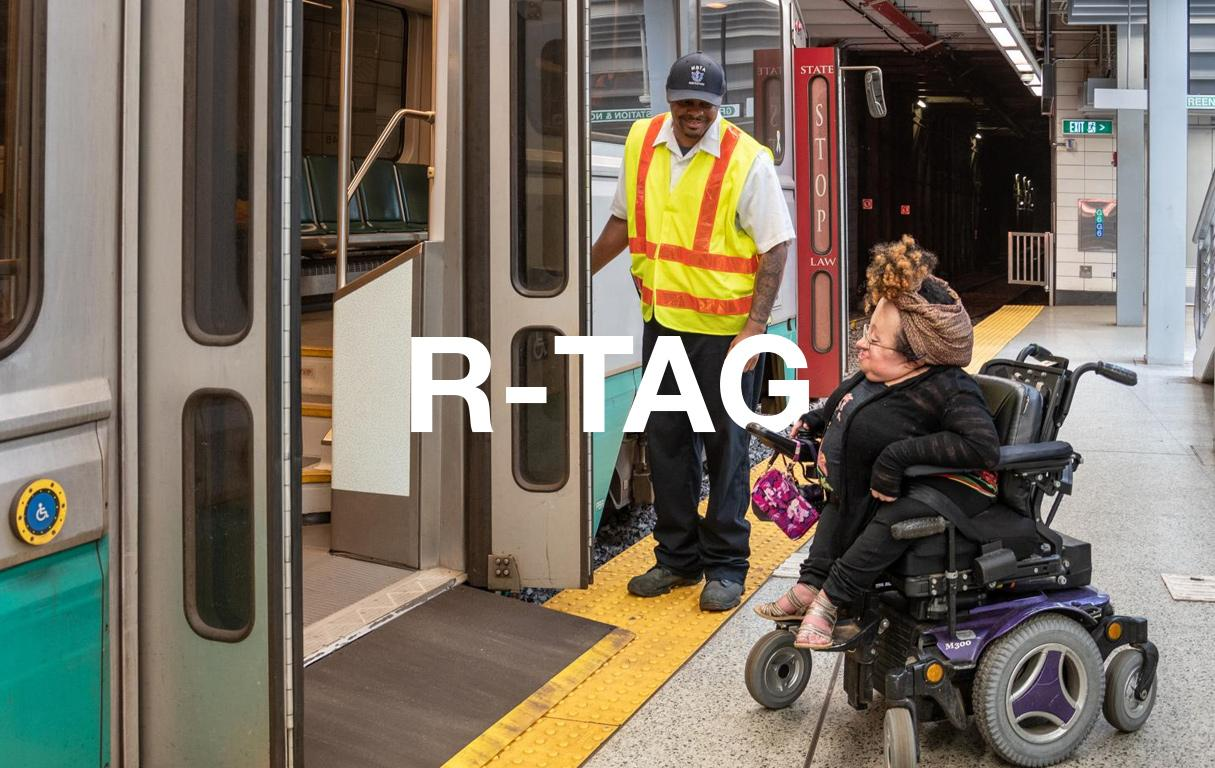 A rider in a wheeled mobility device boards a Green Line train using a bridge plate.