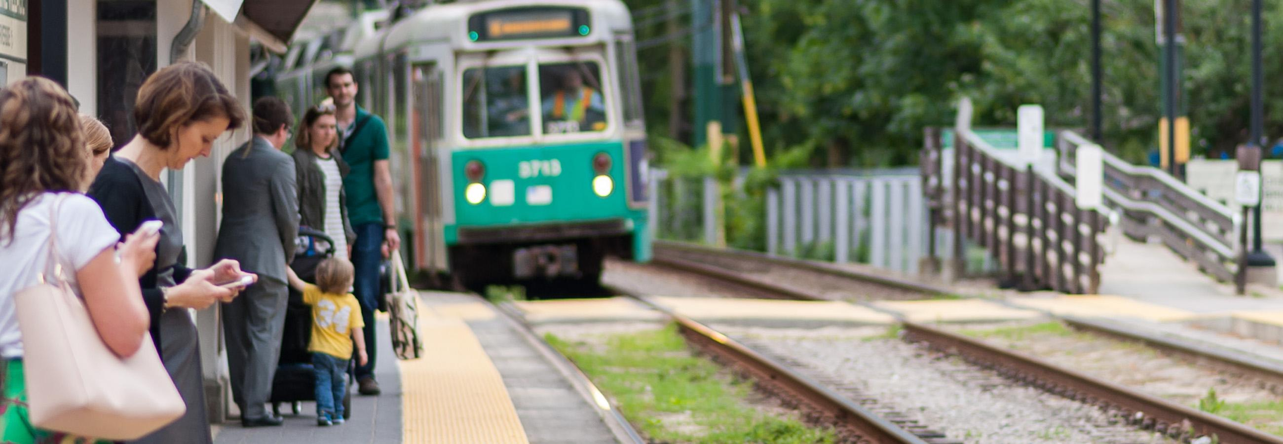 Green Line customers wait at stop