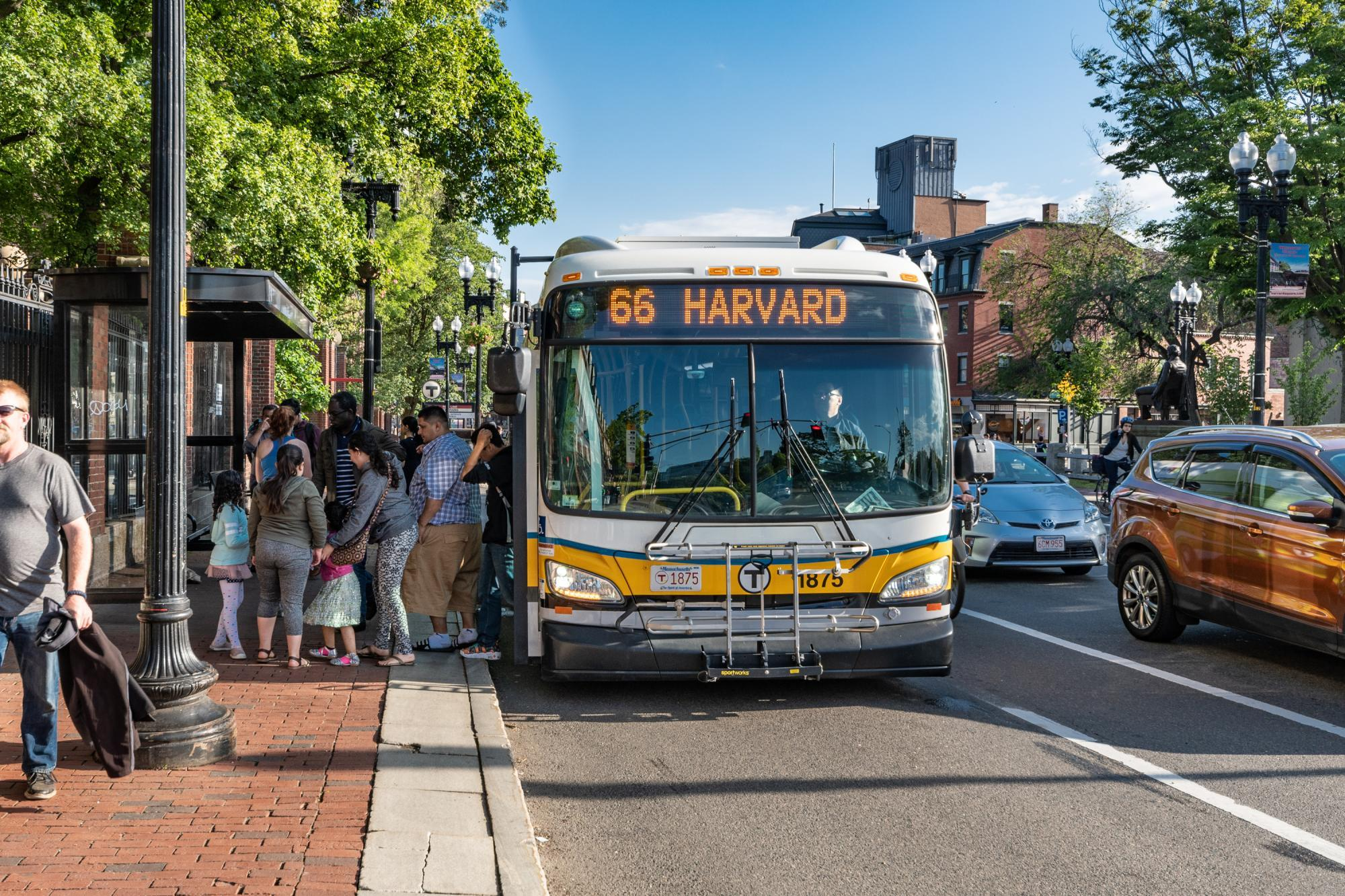 Riders exit a Route 66 bus in Harvard Square