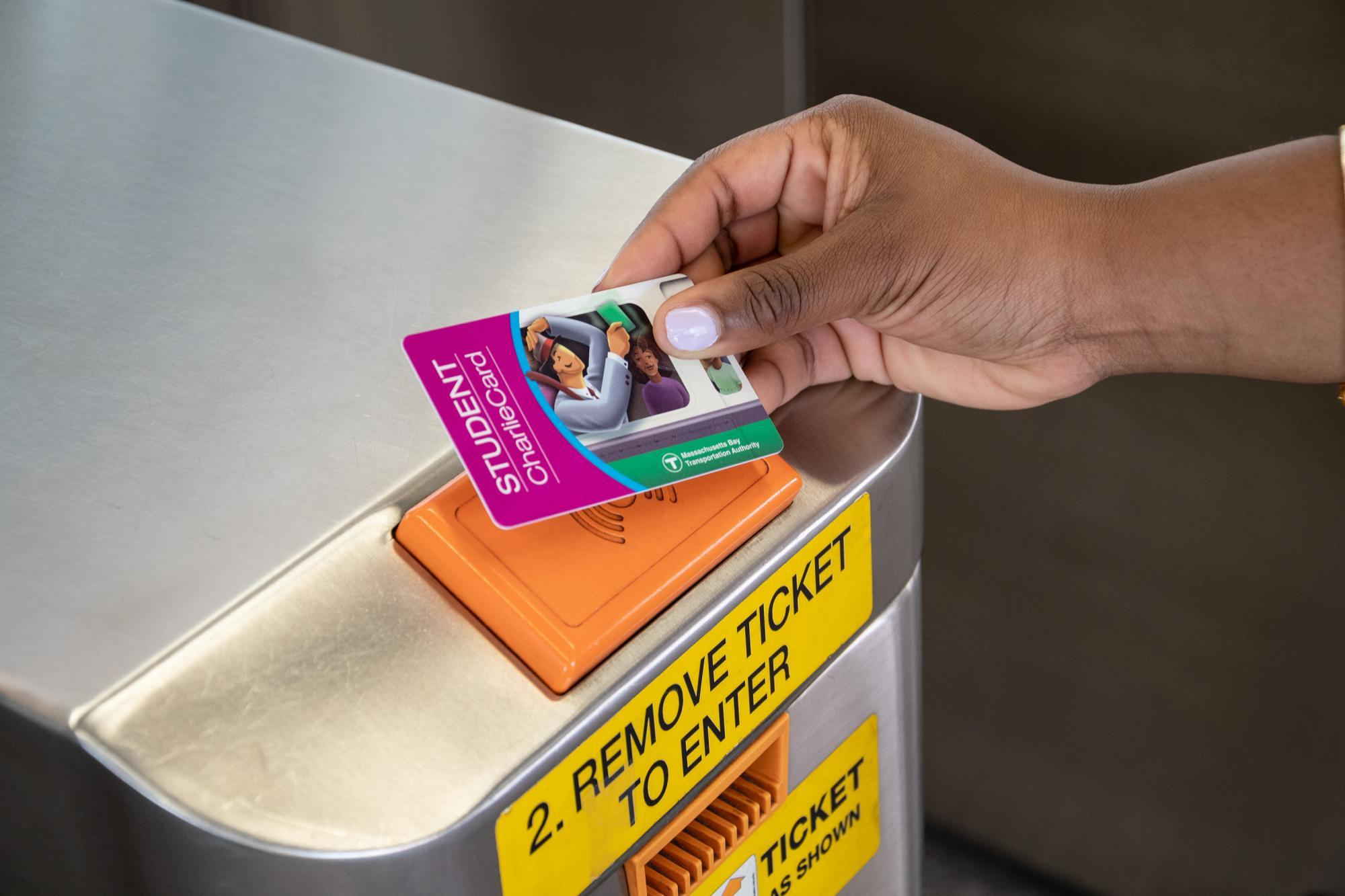 Tapping a purple M7 Student CharlieCard on a subway fare gate