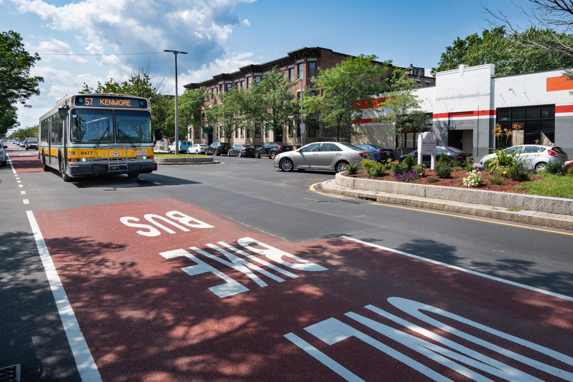 The 57 bus travels in a dedicated bus and bike lane on Brighton Ave in Allston. (July 2019)