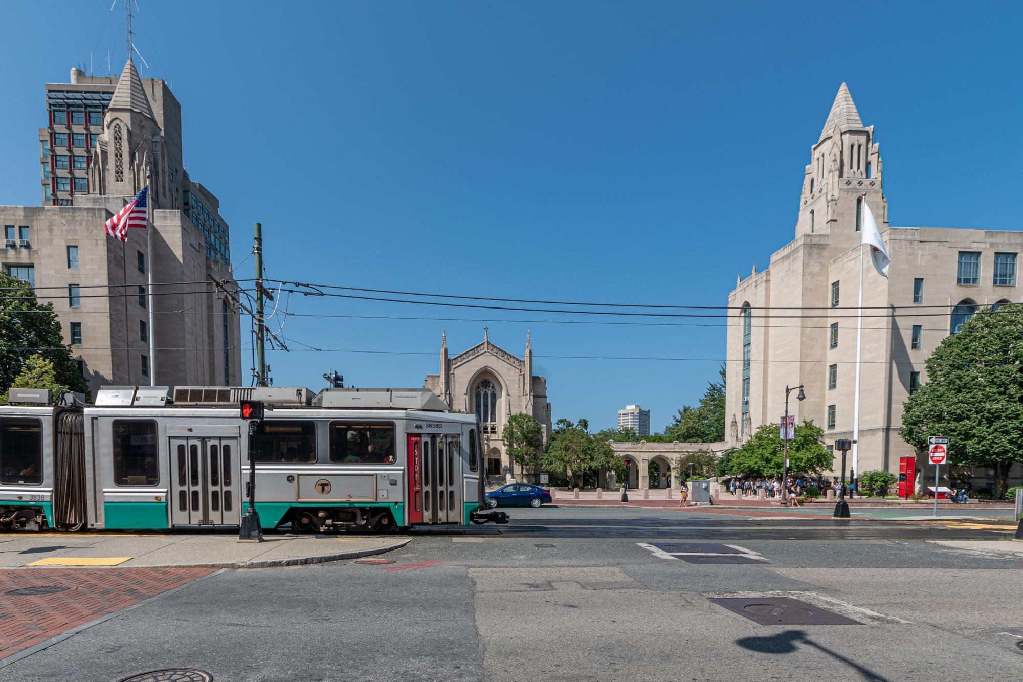 A Green Line B train passes through BU Central, with Marsh Chapel in the background
