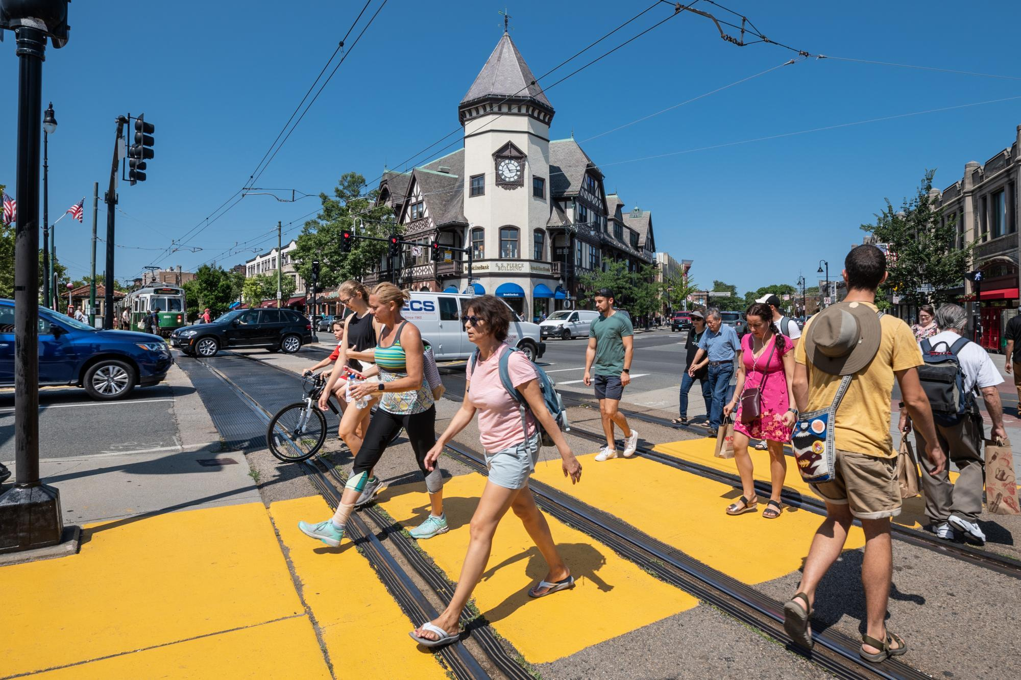 Pedestrians cross the newly repainted crosswalk at Coolidge Corner (August 2019)
