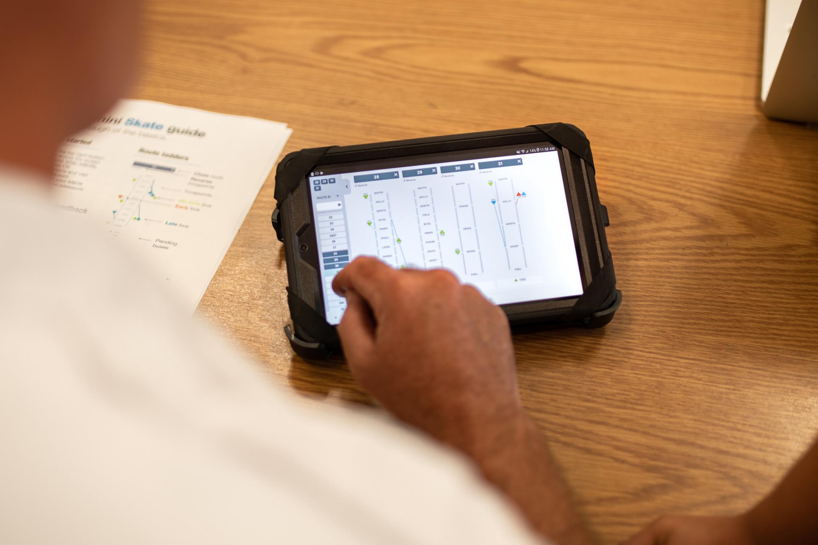 A bus inspector uses Skate, a mobile dispatching app for tablets that we built in-house
