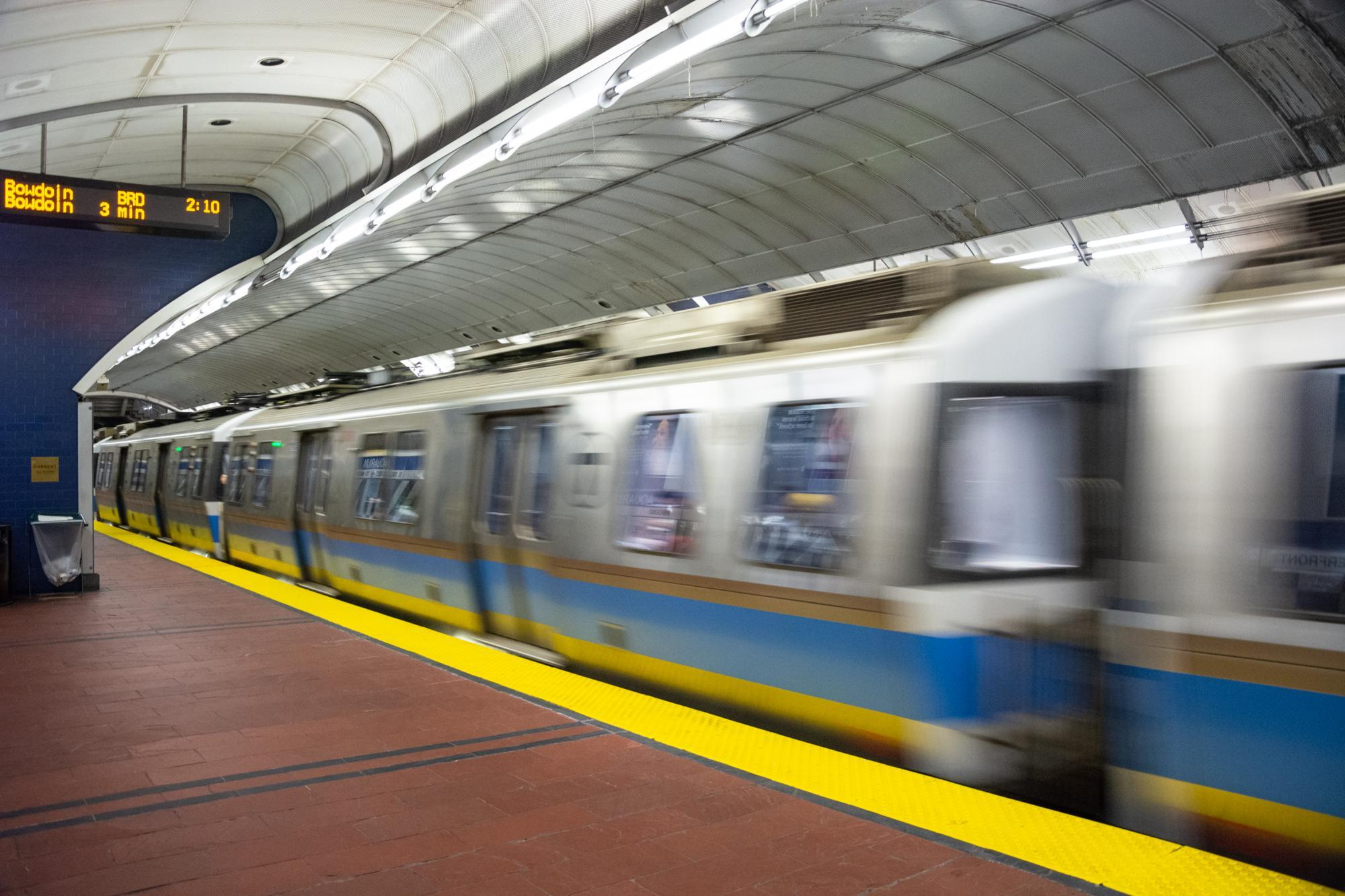 A Blue Line train passes through Aquarium station