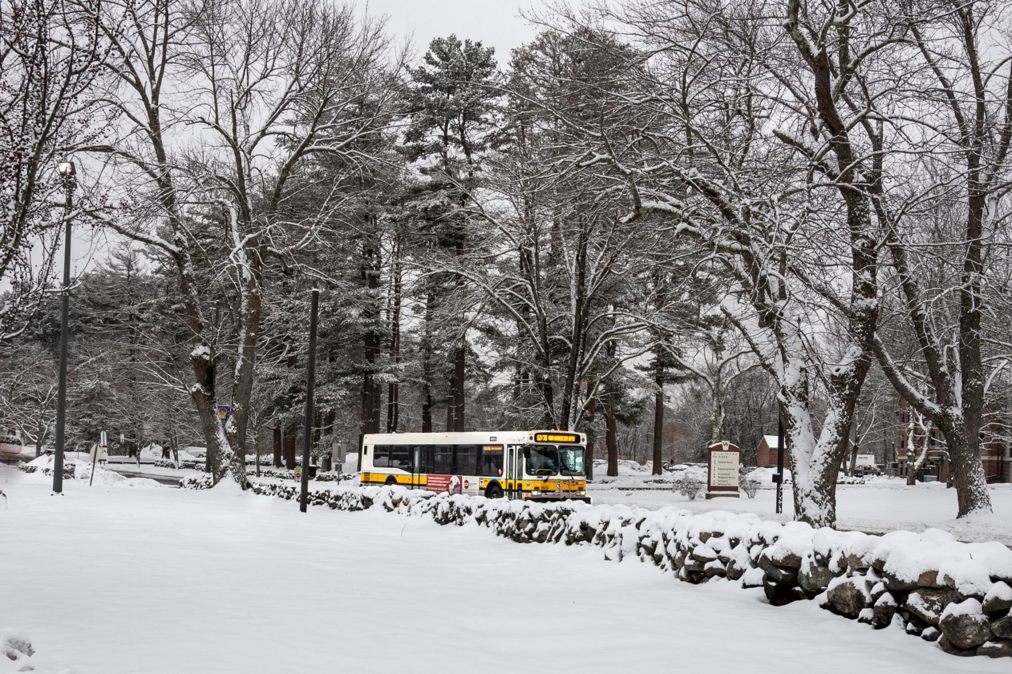 A Route 62/76 bus travels amid snow-covered landscape