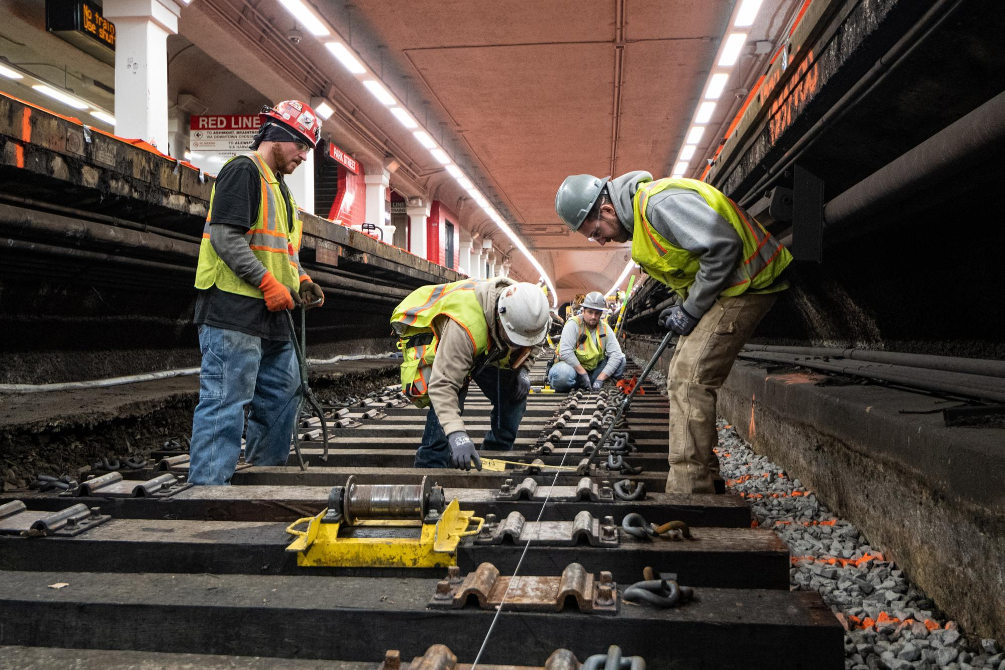 Crew members work on track replacement at Park St during the December 6 – 8, 2019, Red Line weekend shutdown