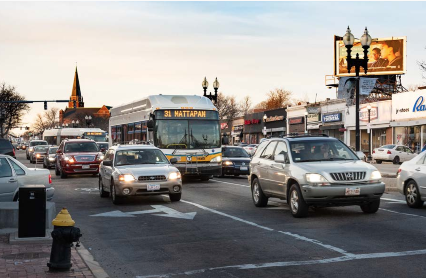 A bus drives in traffic in Mattapan