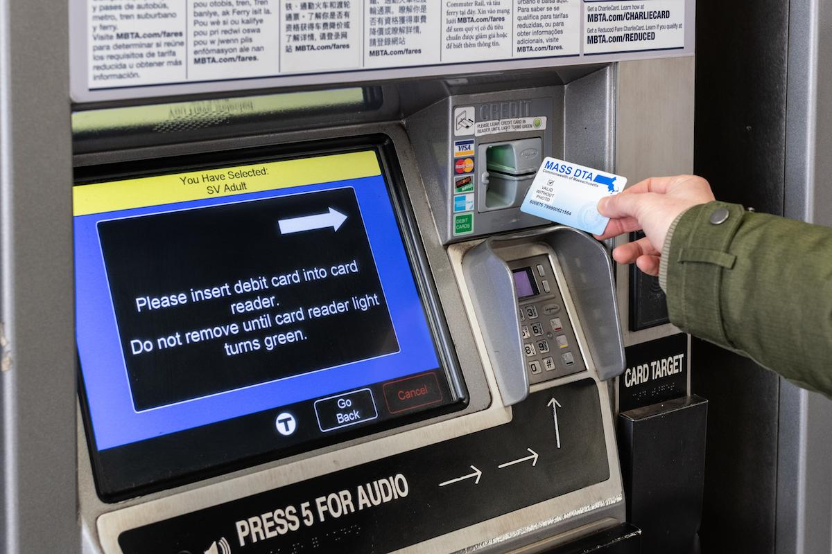 A rider uses an EBT card at a fare vending machine