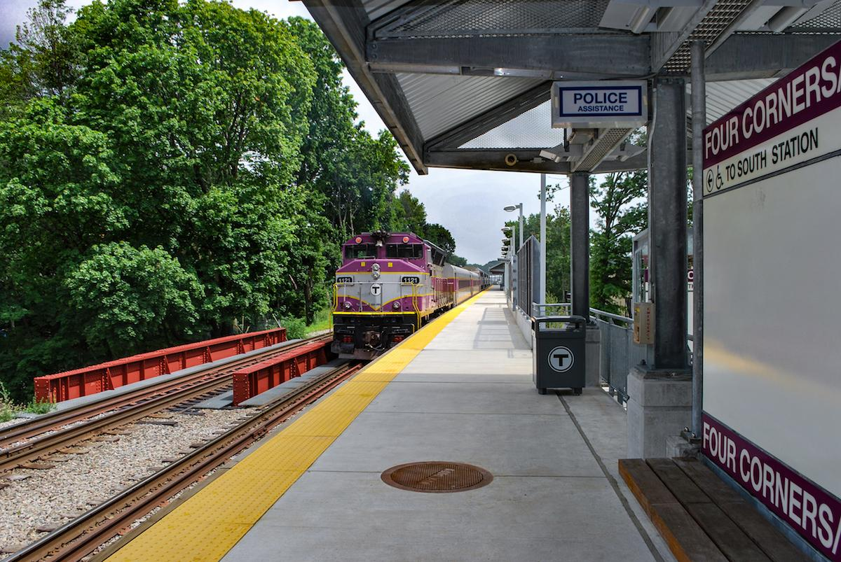 A Commuter Rail train approaches Four Corners Station on the Fairmount Line