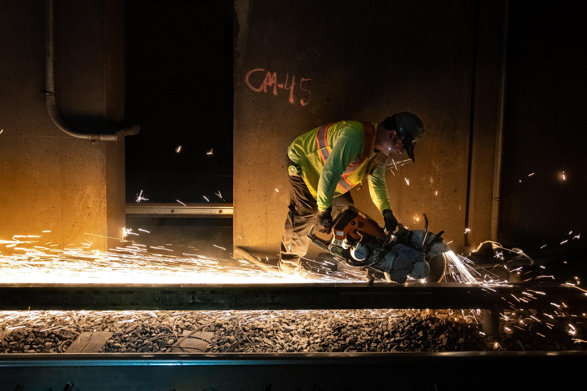 A crew member welds rail on North Station's southbound side during the February 7 – 9, 2020, Orange Line weekend shutdown