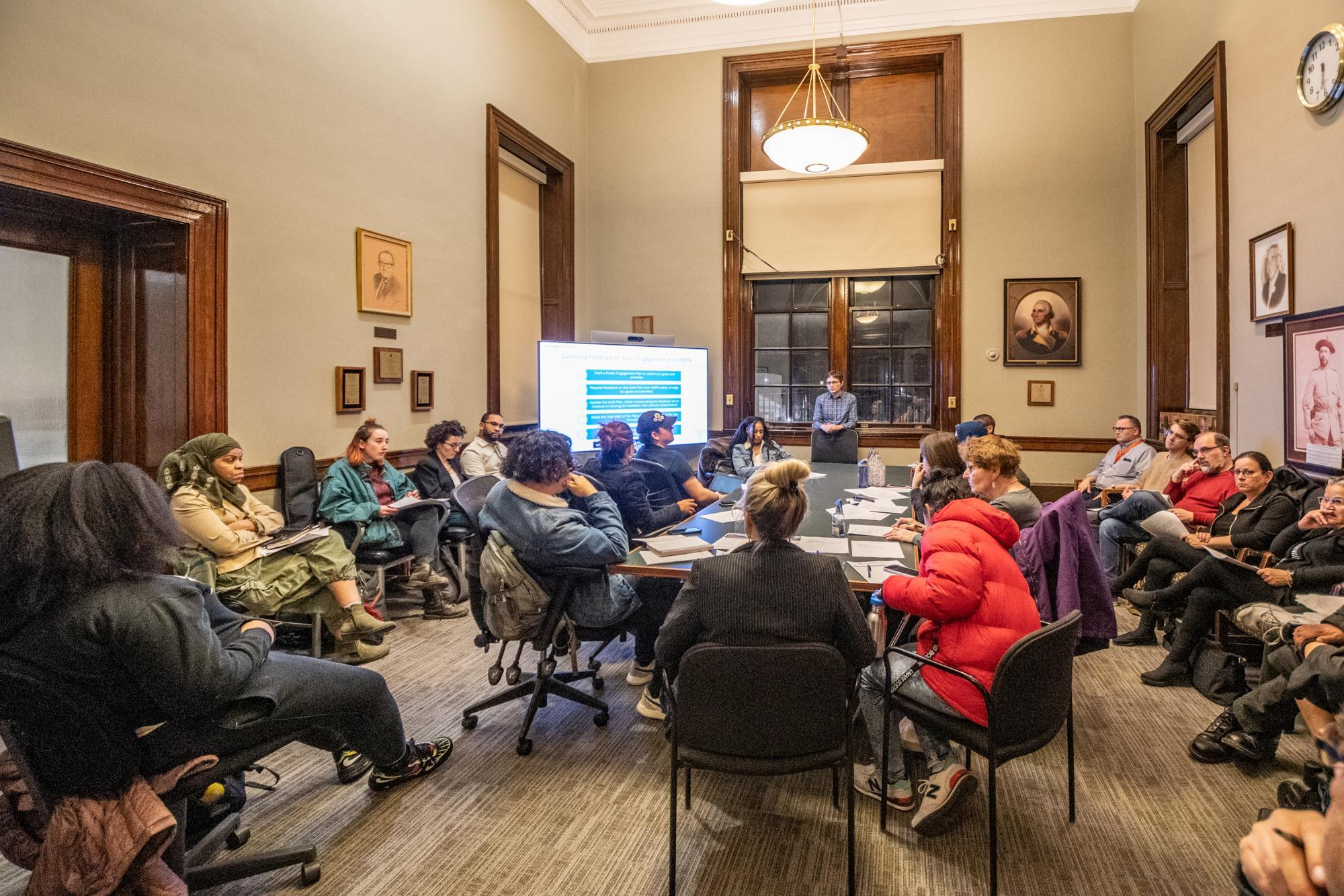 Community members gather in a conference room at Chelsea City Hall to dicsuss the public engagement plan.