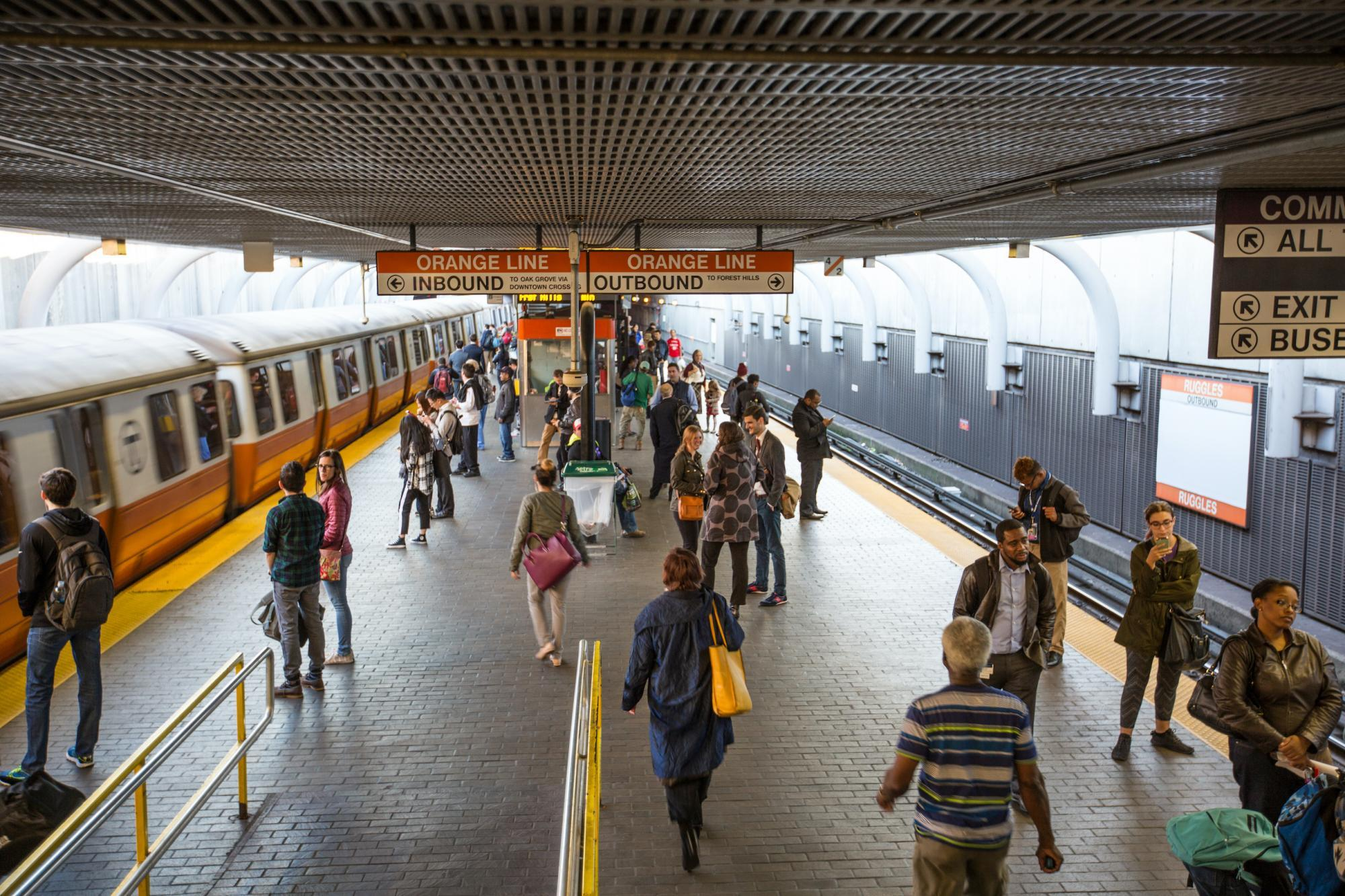 customers on the orange line platform at ruggles T stop