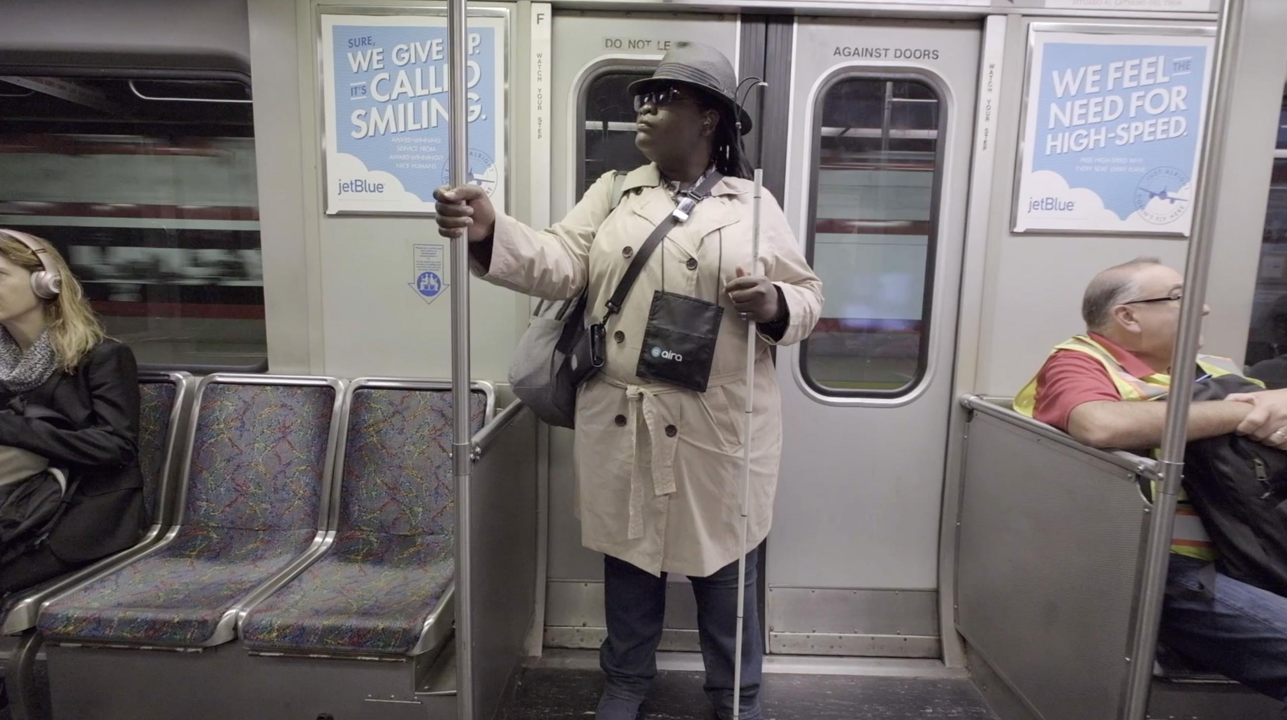 A subway rider participates in a pilot for Aira, an assistive technology for blind and low-vision riders