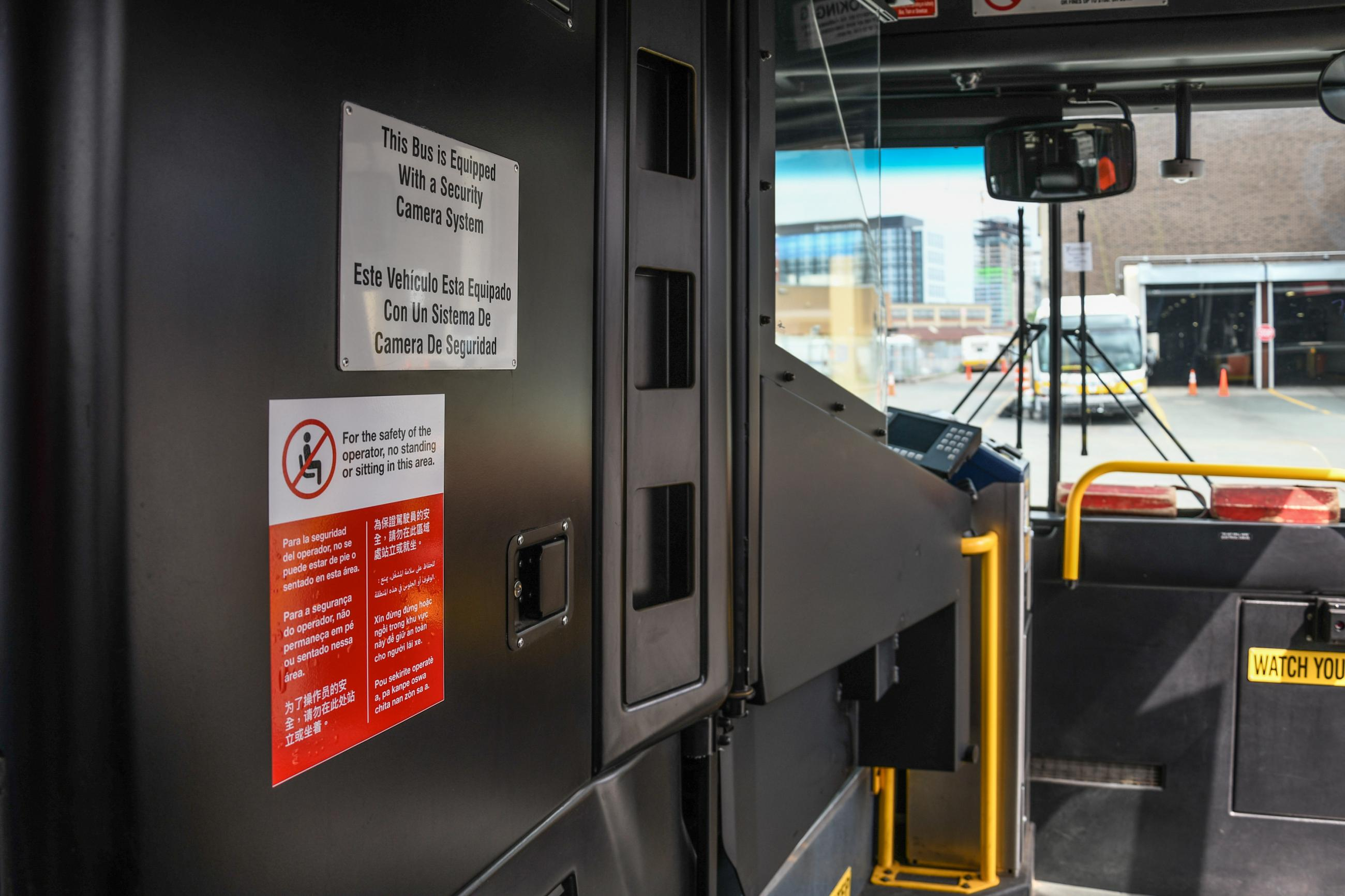 Photo of Protective Barrier on Bus with Decal