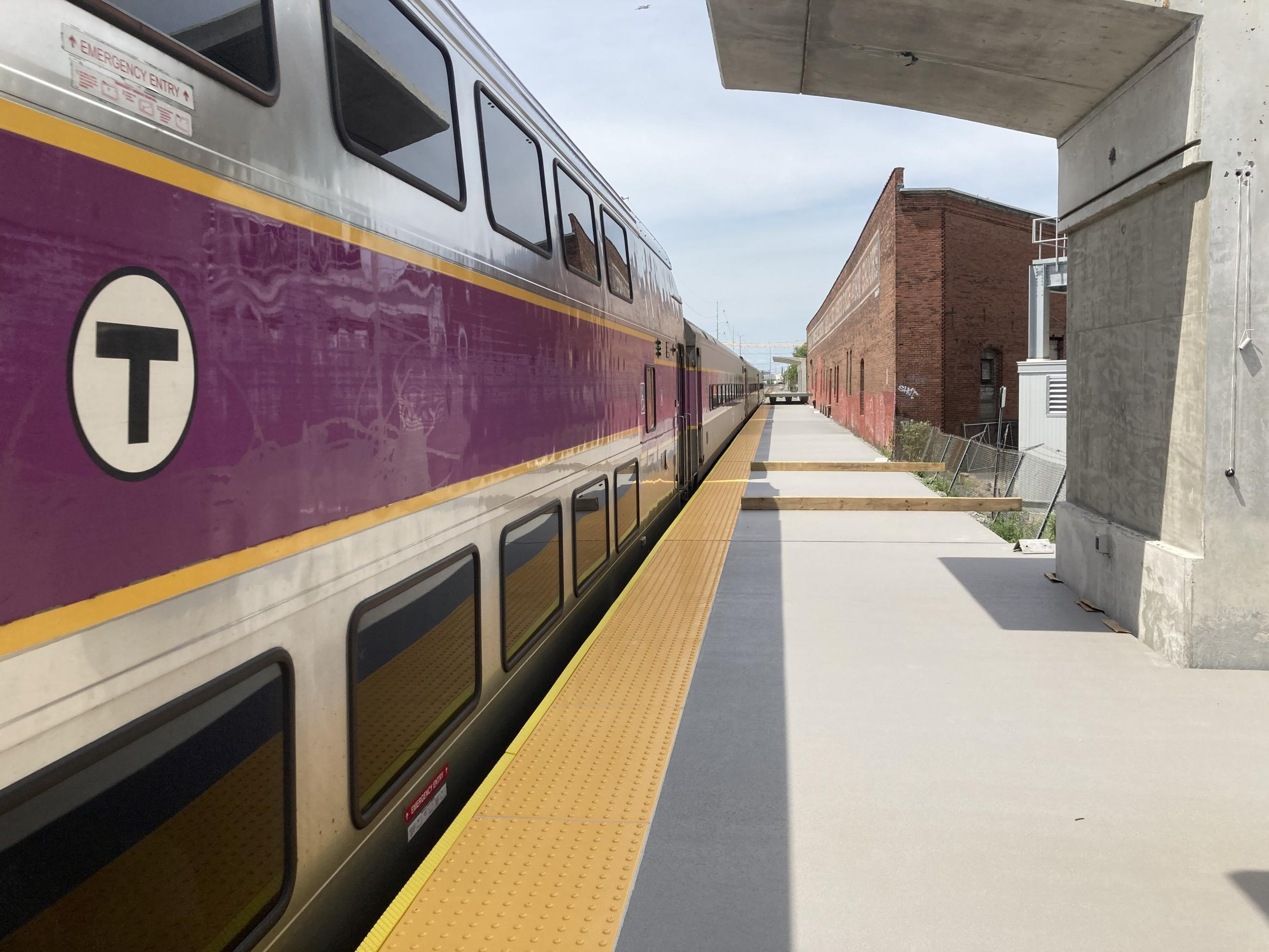 A Commuter Rail train is stopped at the inbound platform at Chelsea Station next to a newly installed platform.