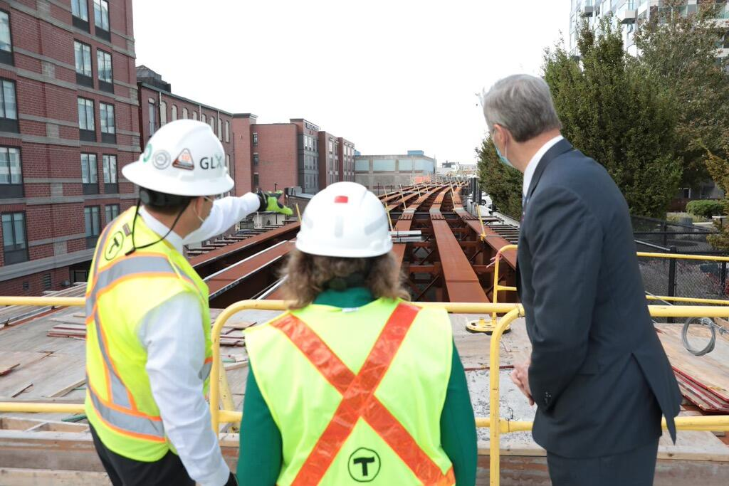GLX Project Manager John Dalton shows Transportation Secretary and CEO Stephanie Pollack and Governor Charlie Baker GLX construction progress.