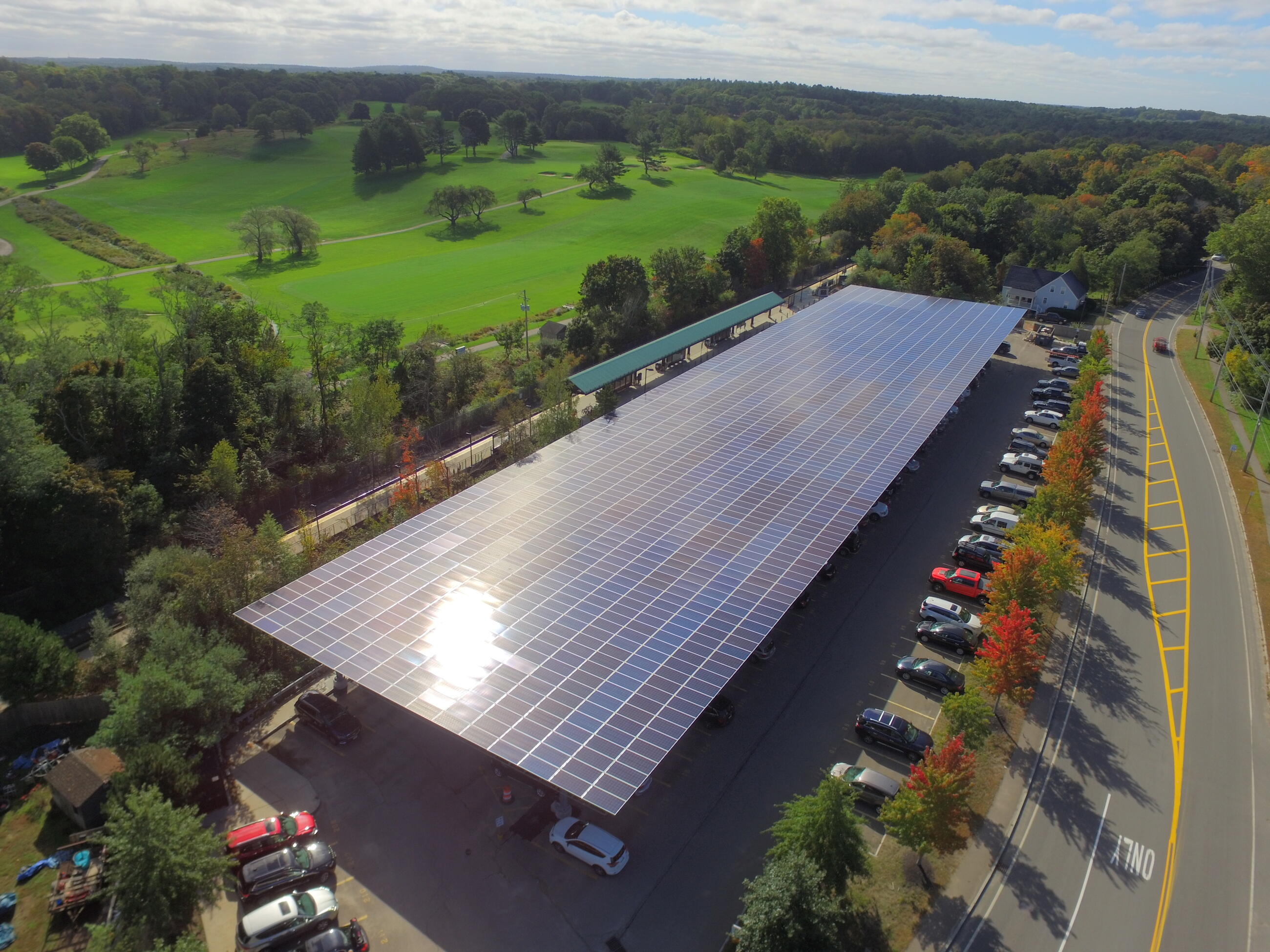 Aerial view of the T's solar canopy covering a parking lot in West Hingham.