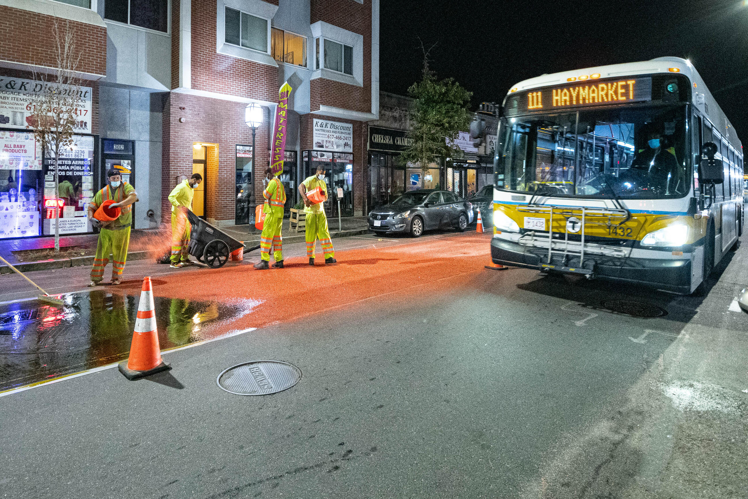 Construction crews installing bus lane markings on Broadway in Chelsea in October 2020.