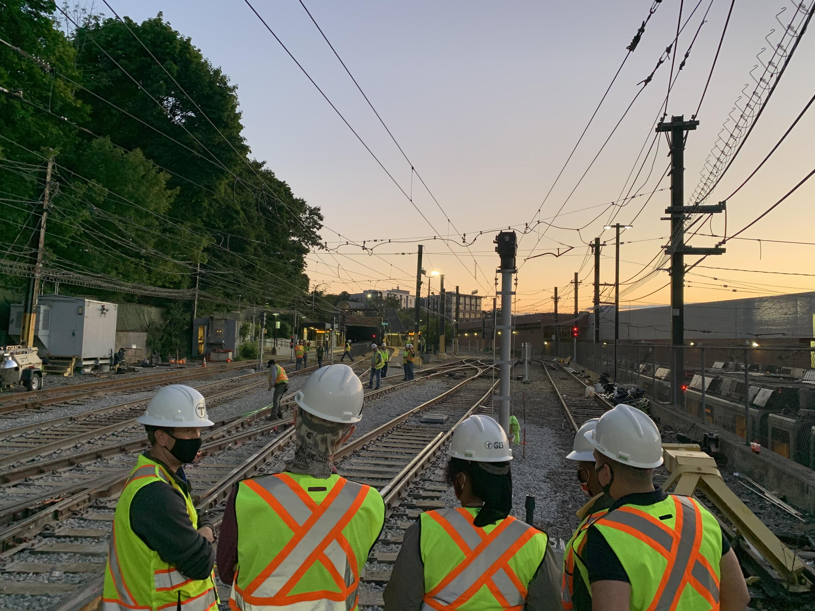 Crews work on the tracks as part of the Green Line Transformation project