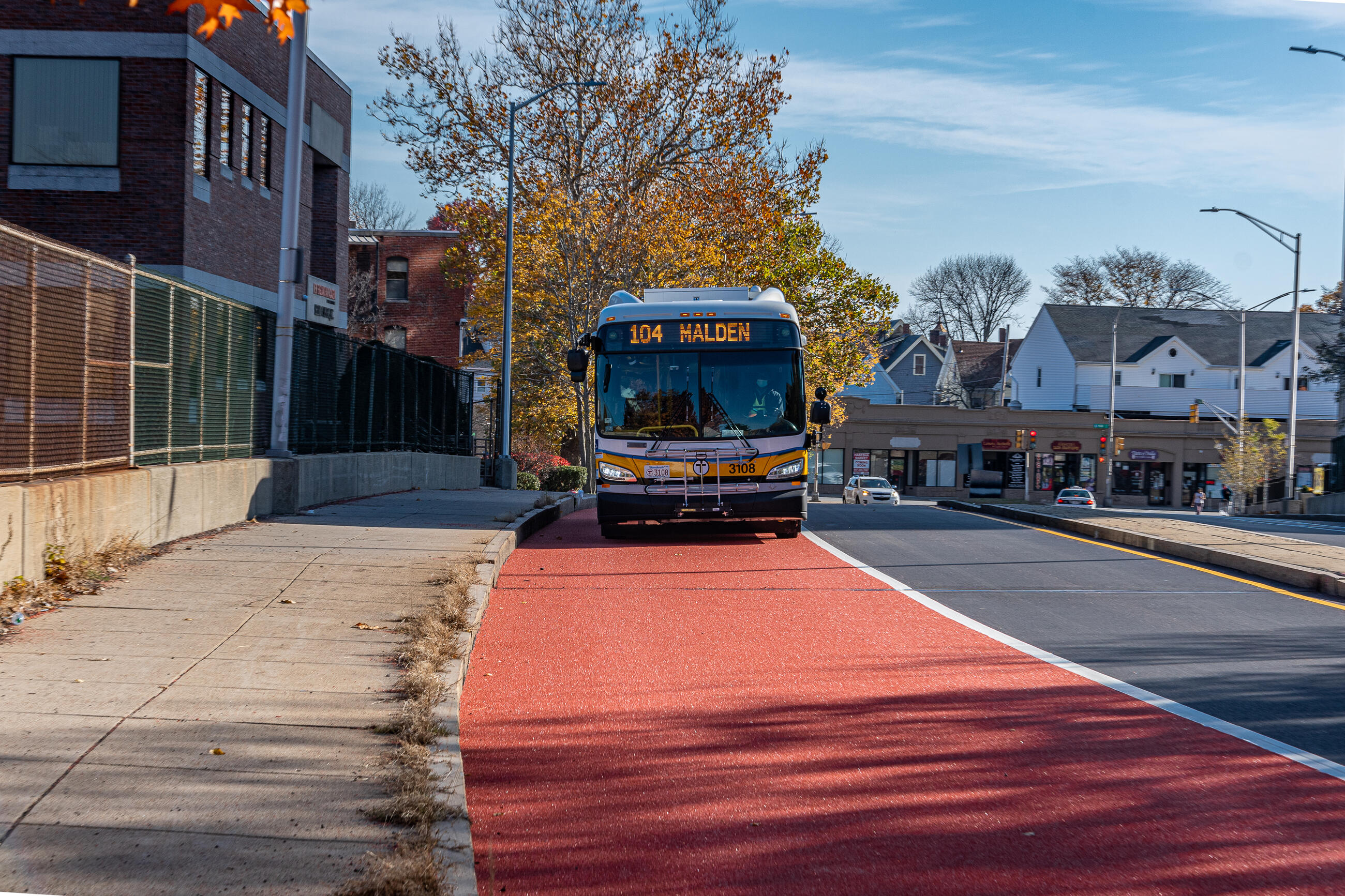 Route 104 bus using the new Florence Street bus lane approaching Malden Center Station.