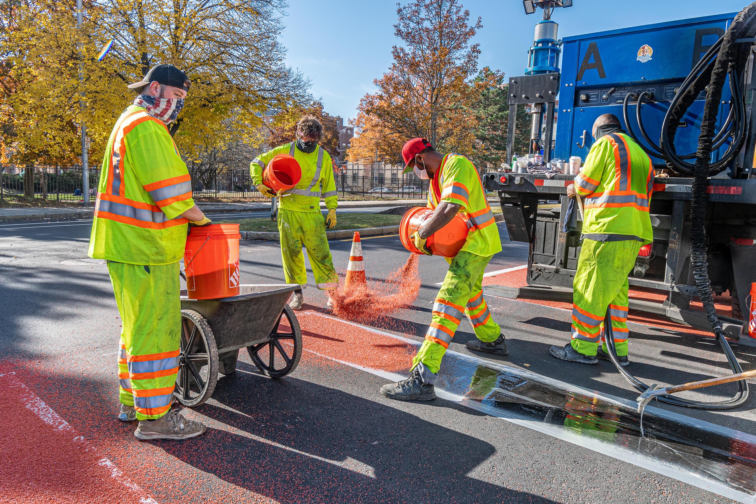 Road crews installing the Florence Street bus lane on November 9, 2020.