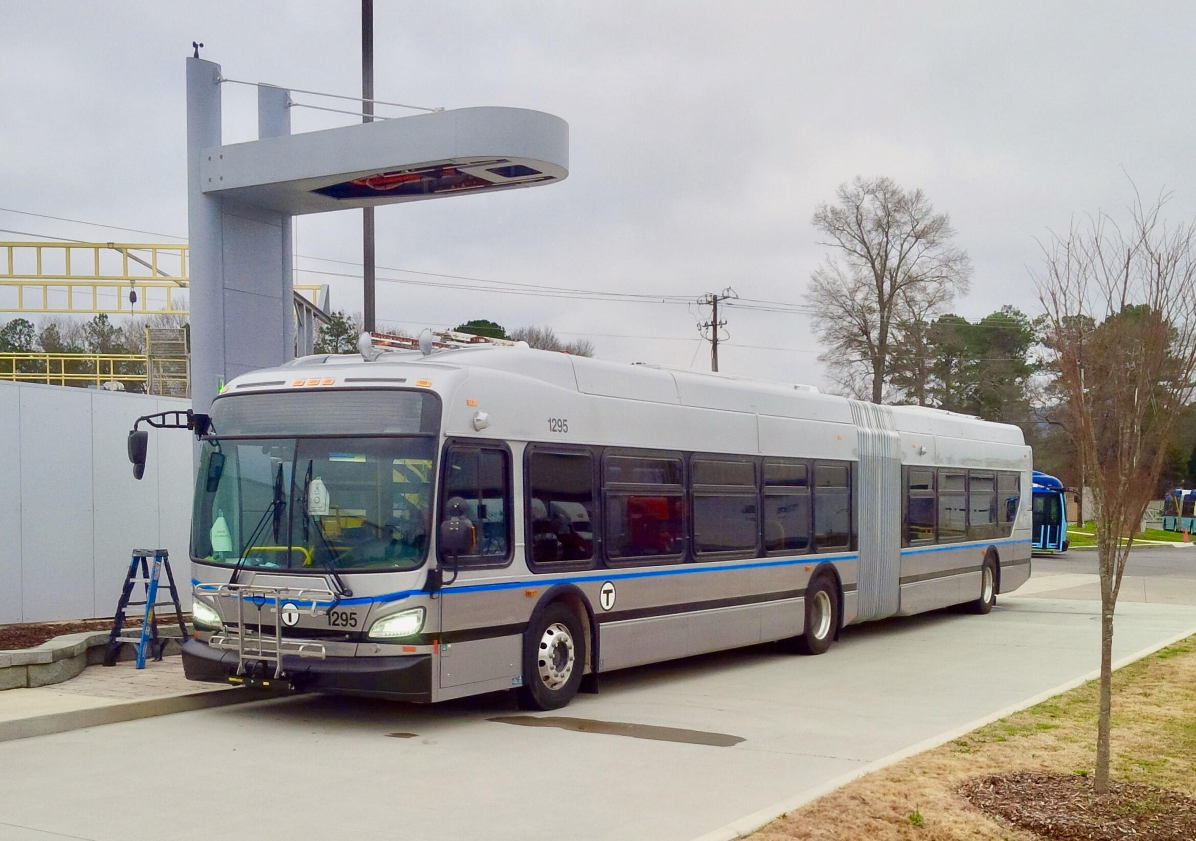 A Silver Line Battery Electric Bus (BEB) with an example of en-route charging equipment.
