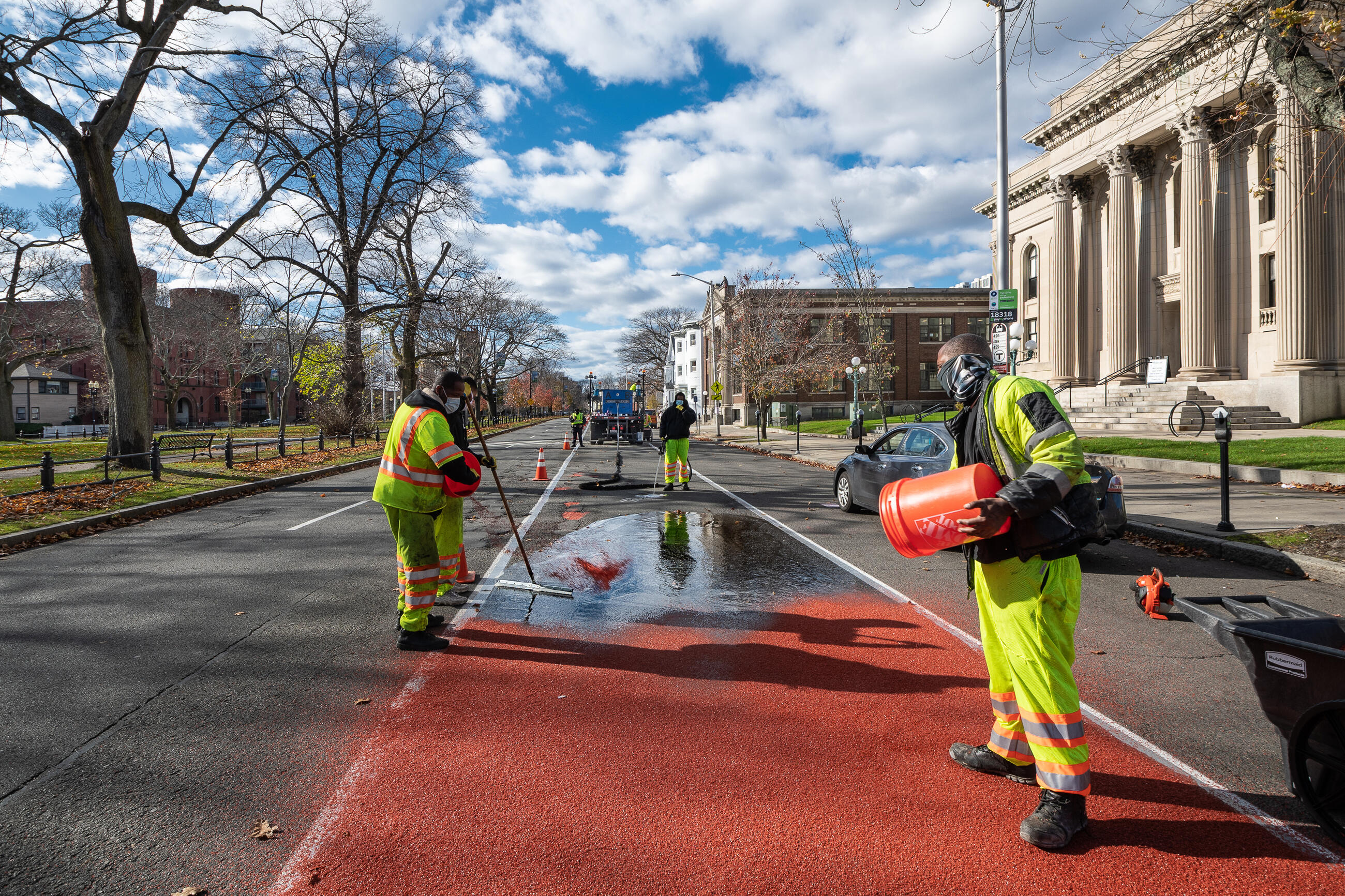 Construction crews installing a segment of the bus lane on North Common Street near the Lynn Public Library in November 2020.