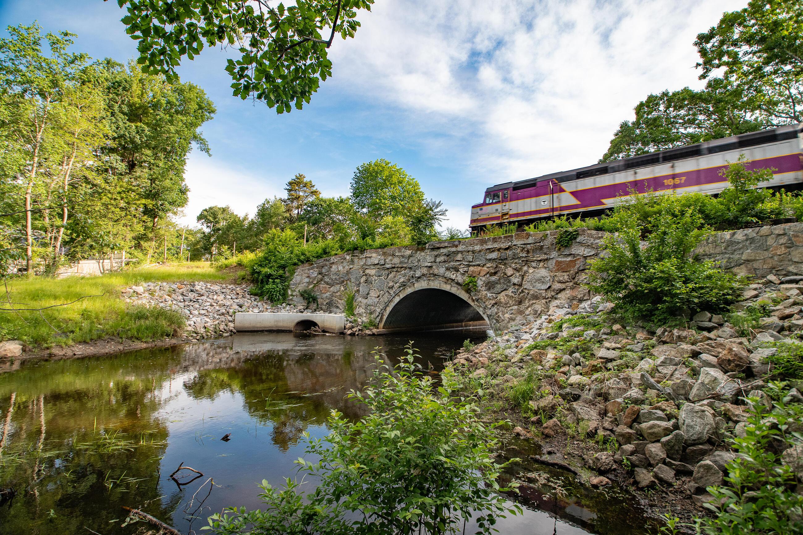 Commuter Rail passing over Shawsheen River Bridge and waterway