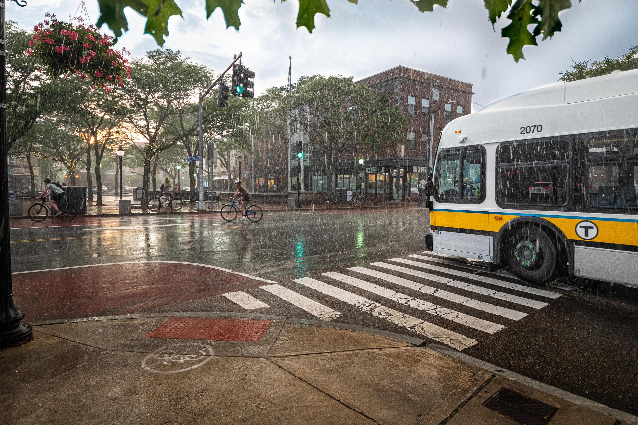 intersection in Davis Square with MBTA in heavy rain