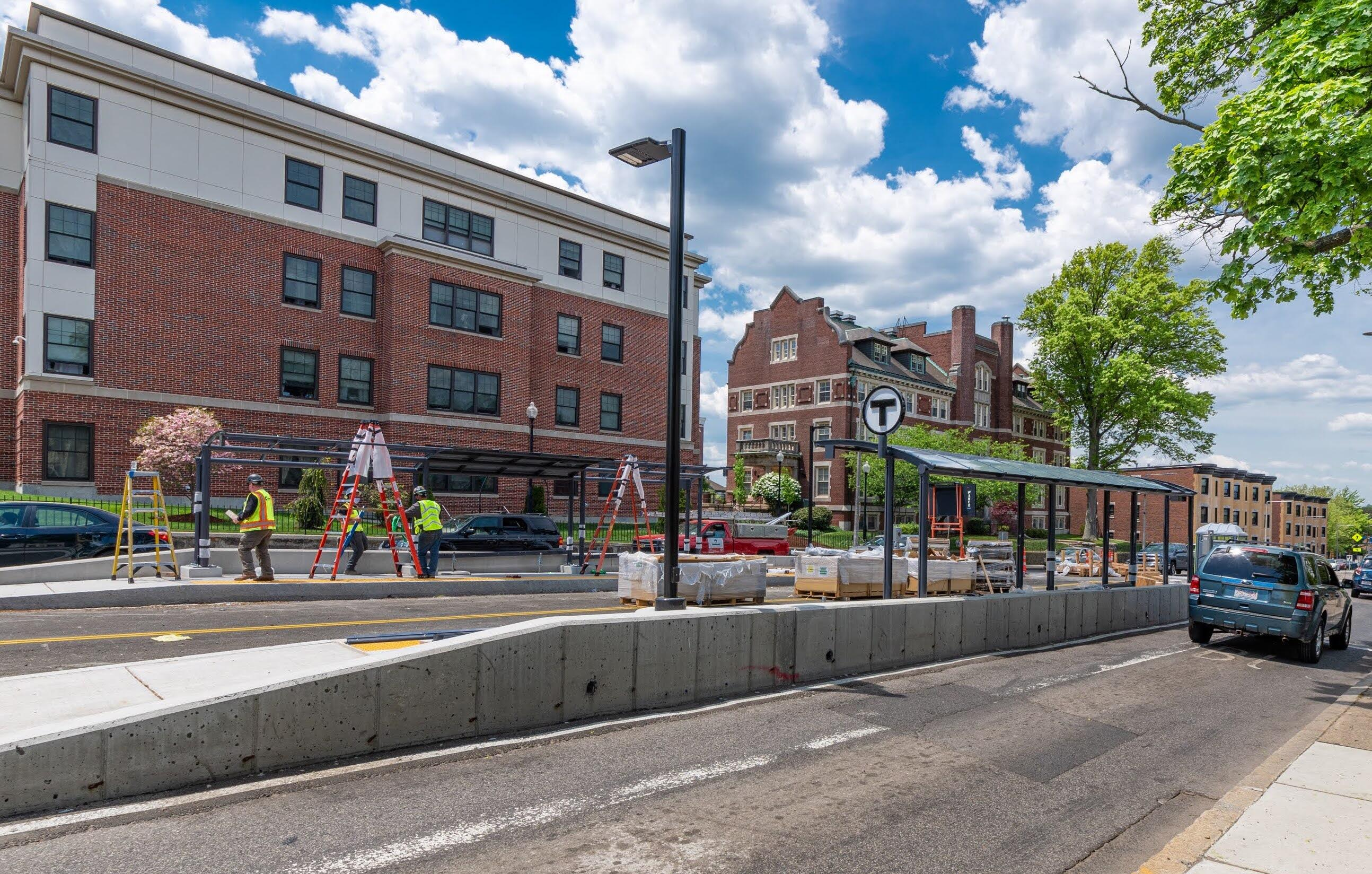 A newly completed canopy shelter on the Columbus Avenue center bus lane. Another canopy is under construction across the road.