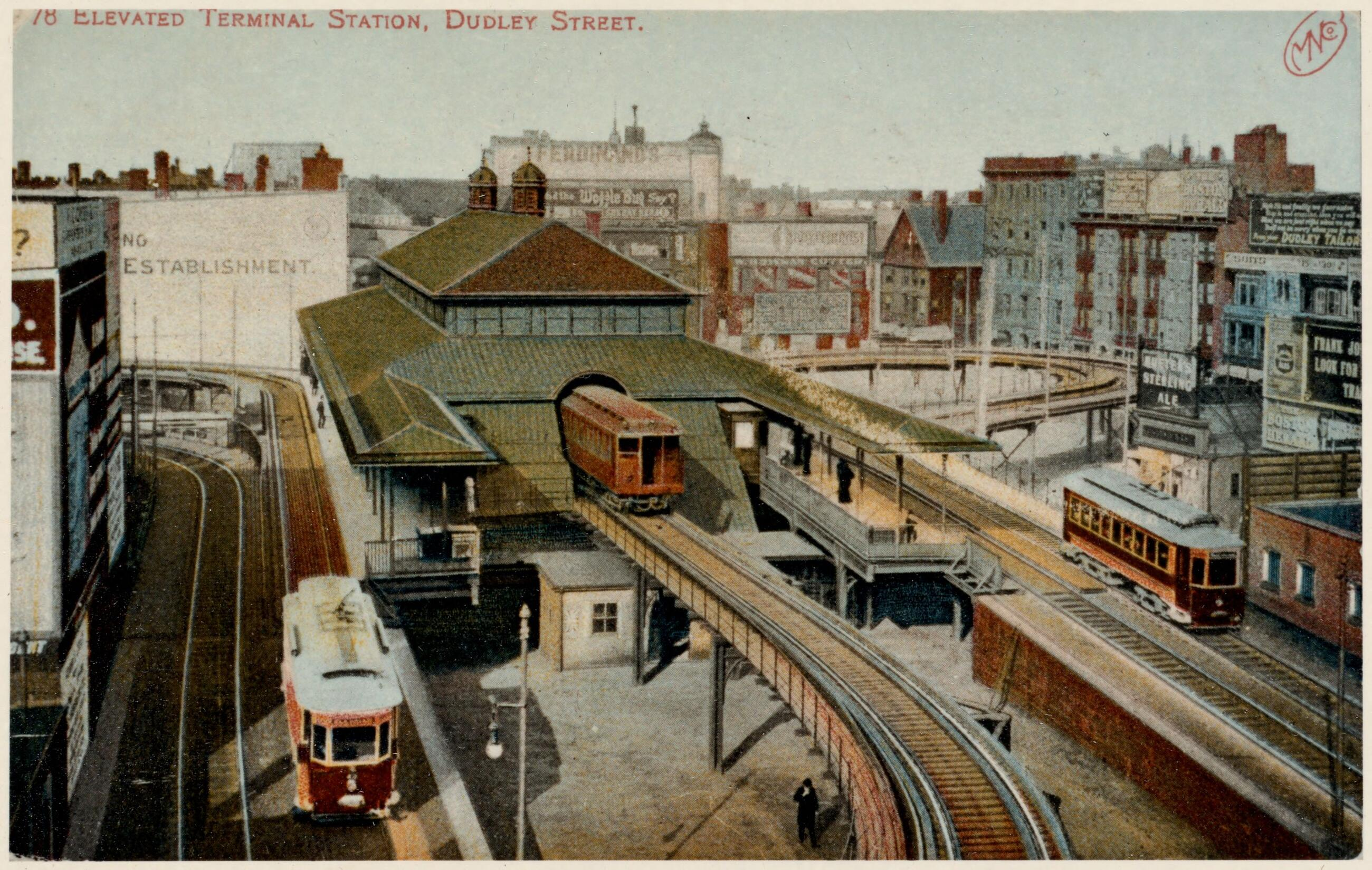 Elevated trains depart from Dudley Station.