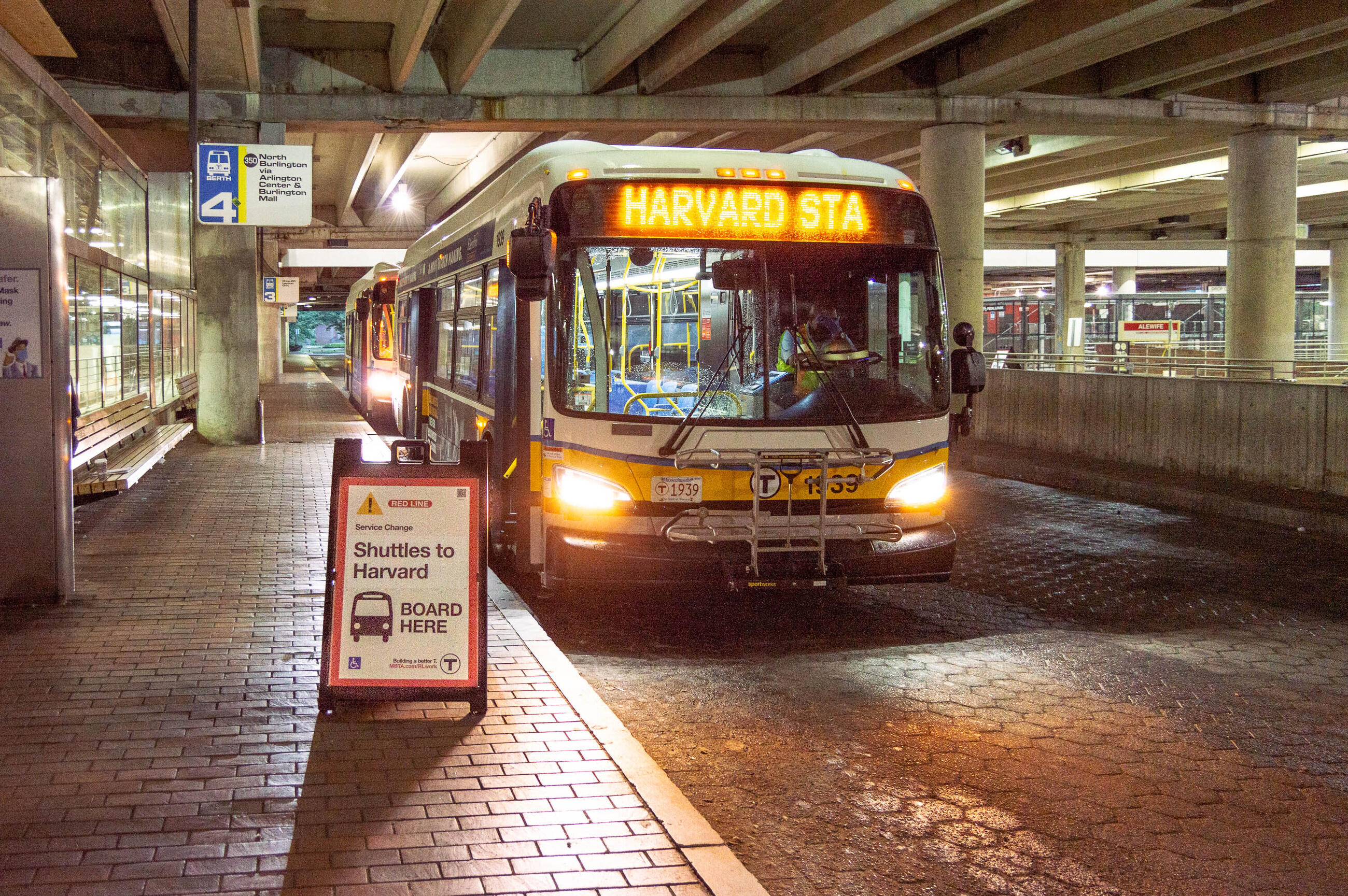 a shuttle bus heading to Harvard waits at the Alewife busway