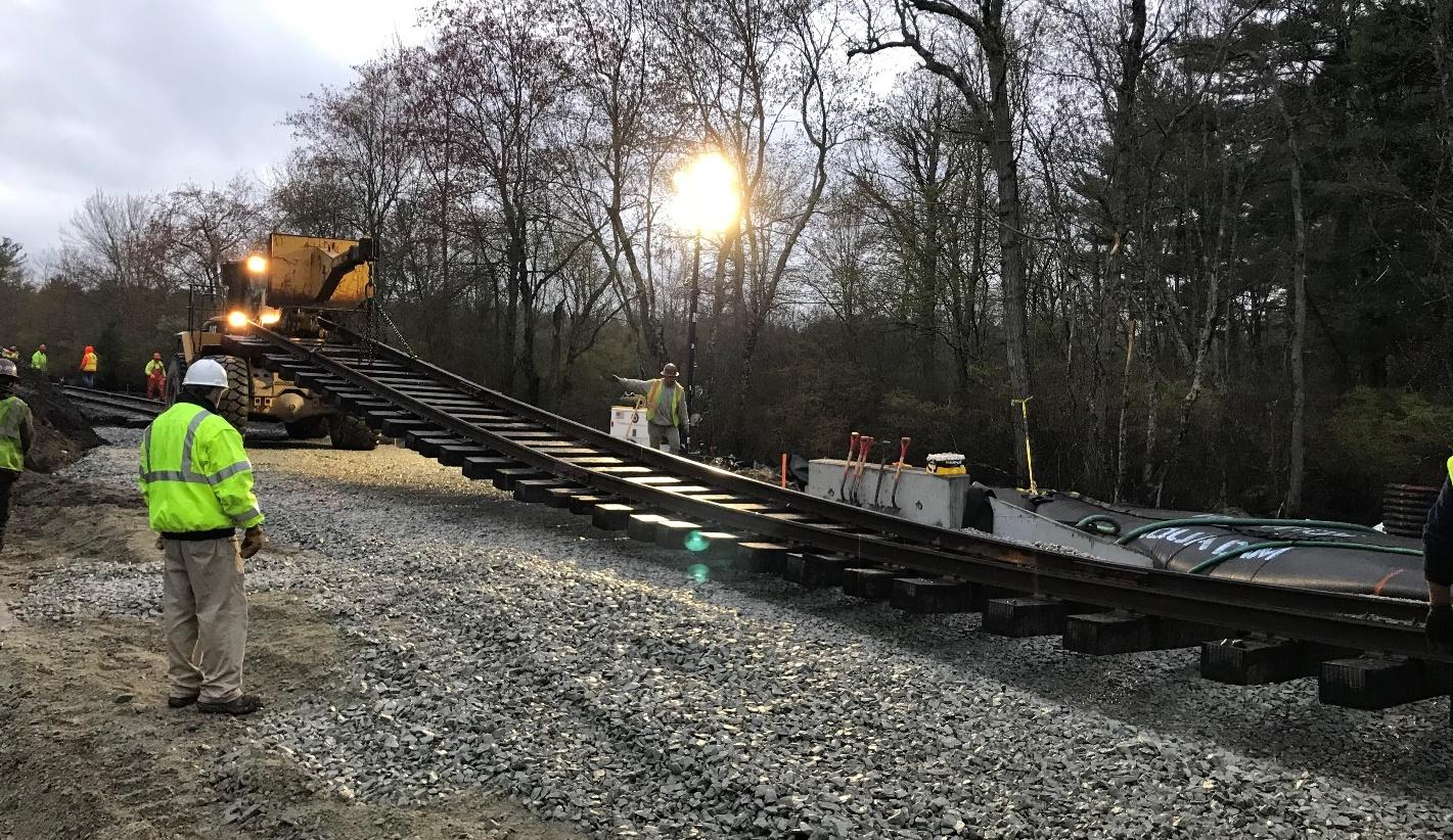 Track is reinstalled after culvert work in Berkley as part of the South Coast Rail project