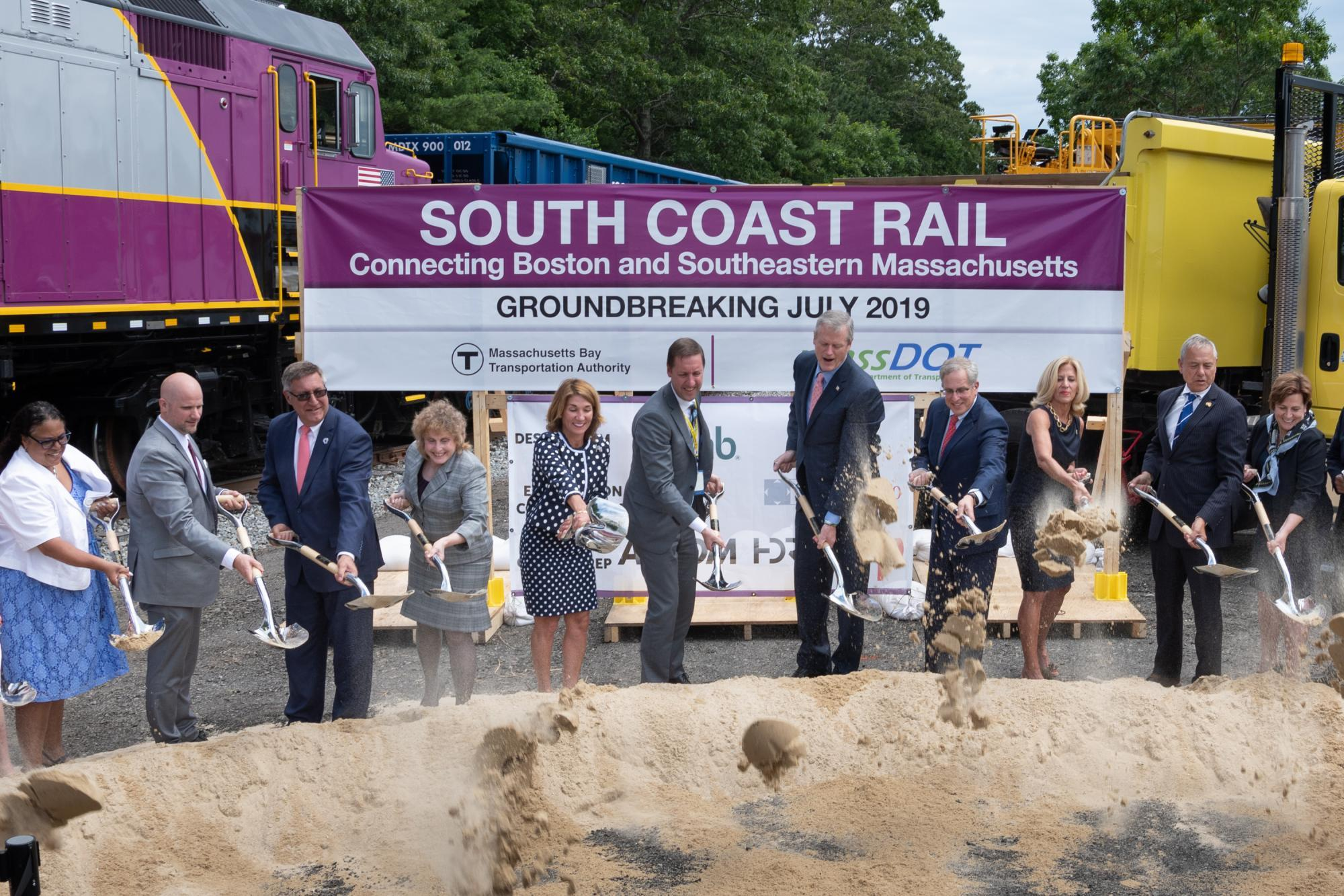 Officials with shovels at the groundbreaking of South Coast Rail