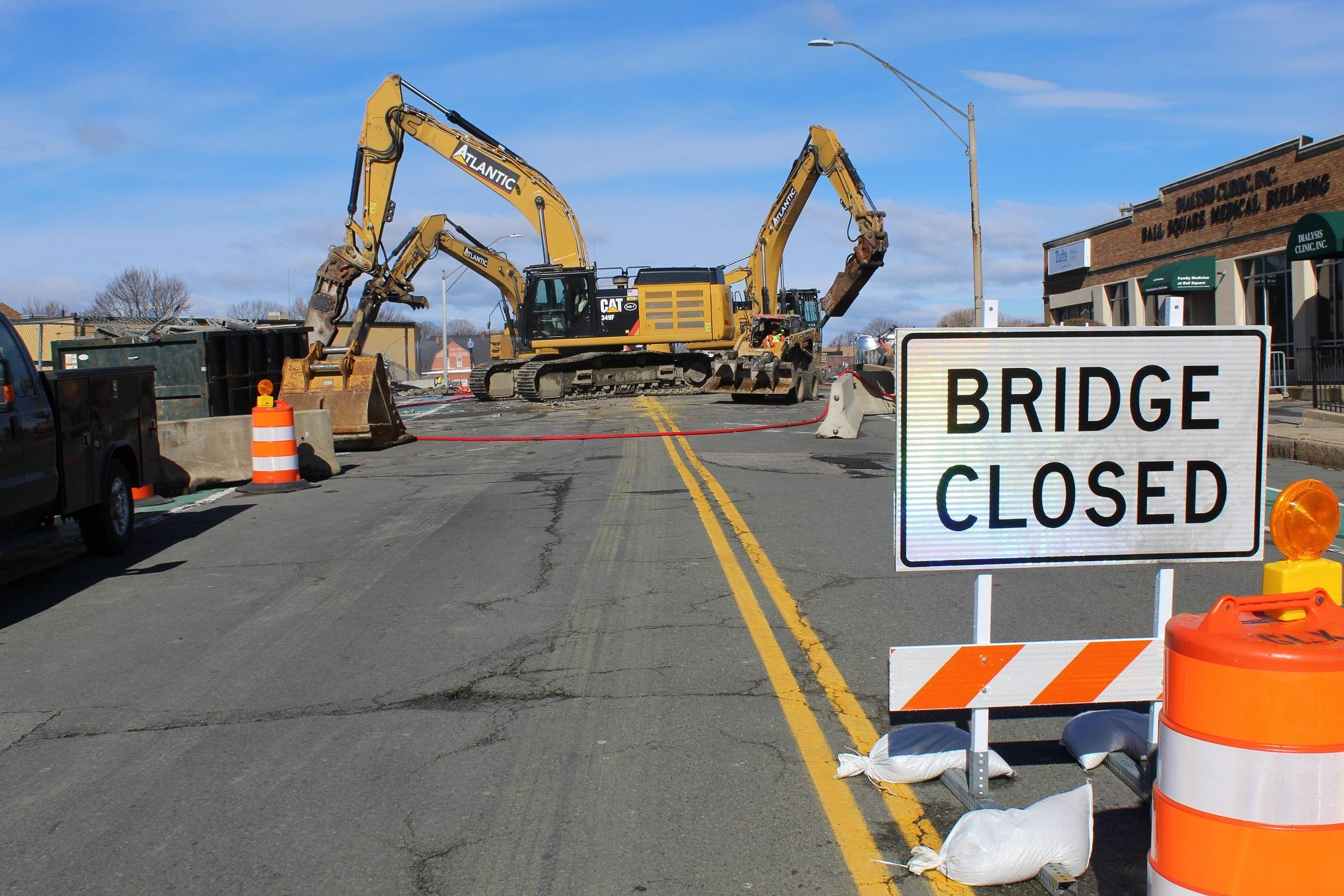 Demolition heavy machinery on the Broadway Bridge, with a BRIDGE CLOSED sign in the foreground.