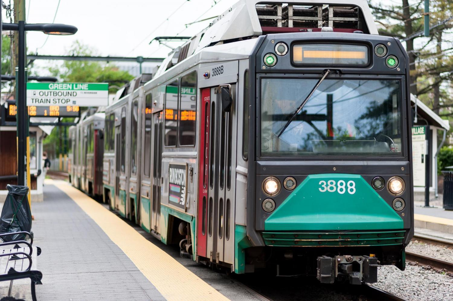 A Green Line train pulls into a station
