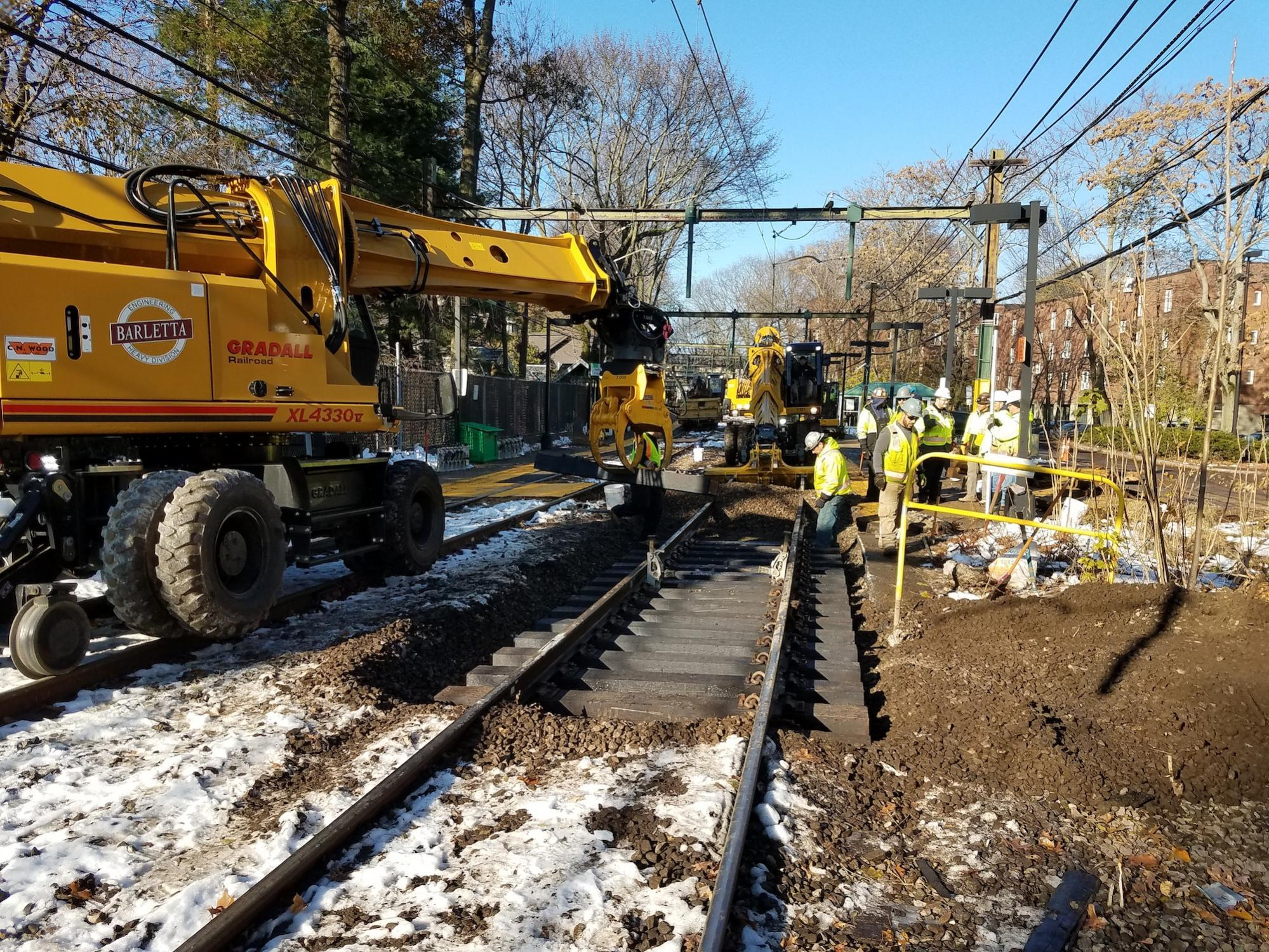 Placing new railroad ties along the D Branch (November 2018)