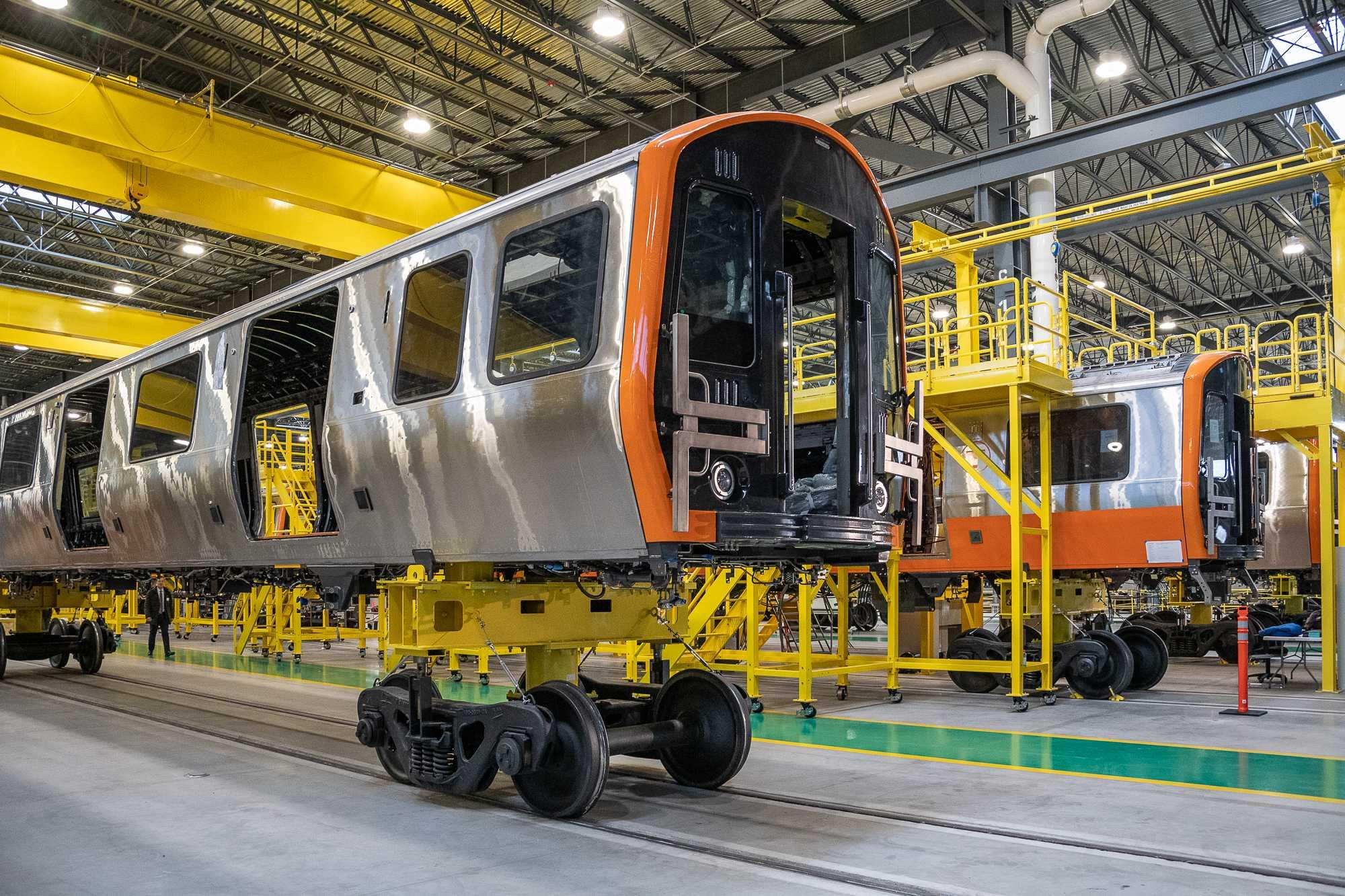 New Orange Line Car on a lift, separated from its wheels