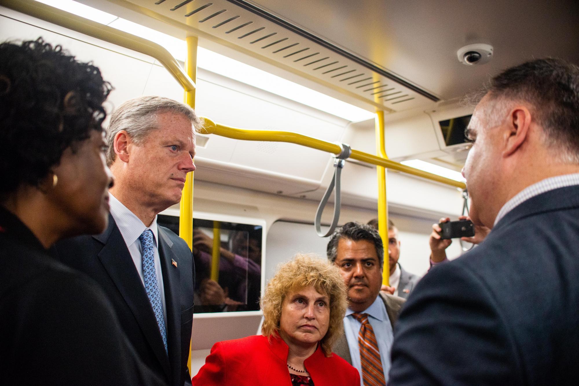 Governor Charlie Baker, Transportation Secretary Stephanie Pollack, and MBTA General Manager Luis Ramirez inside the Red Line mock-up car.