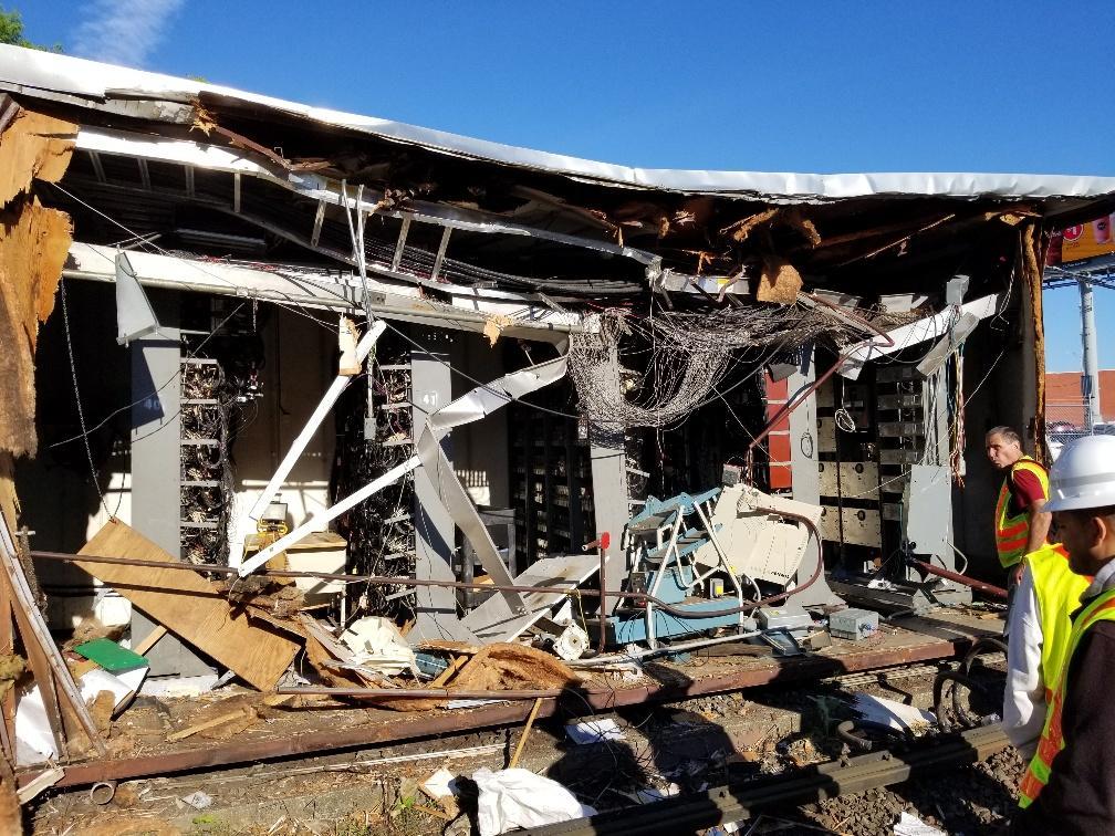 Crews inspect damage to the signal house at JFK/UMass