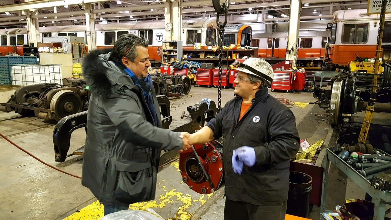 MBTA General Mangaer Luis Ramirez shakes hands with employee at Wellington Yard after a snowstorm